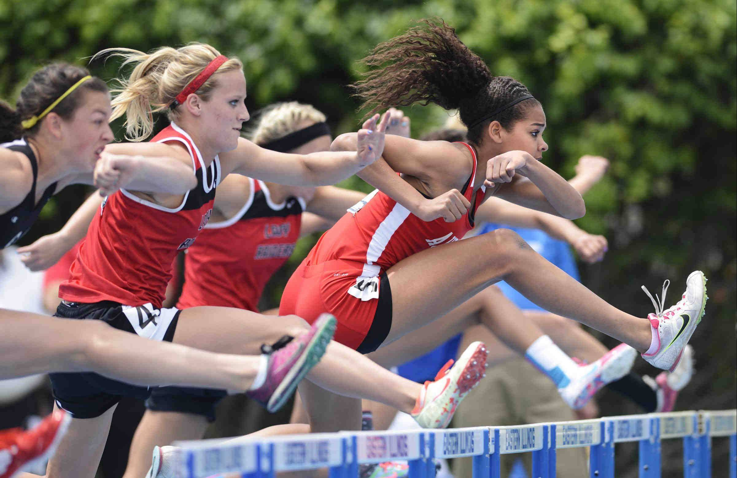 Aurora Christian�s Peyton Wade leads the field over the first hurdle on her way to a state championship in the 100 meter high hurdles Saturday.