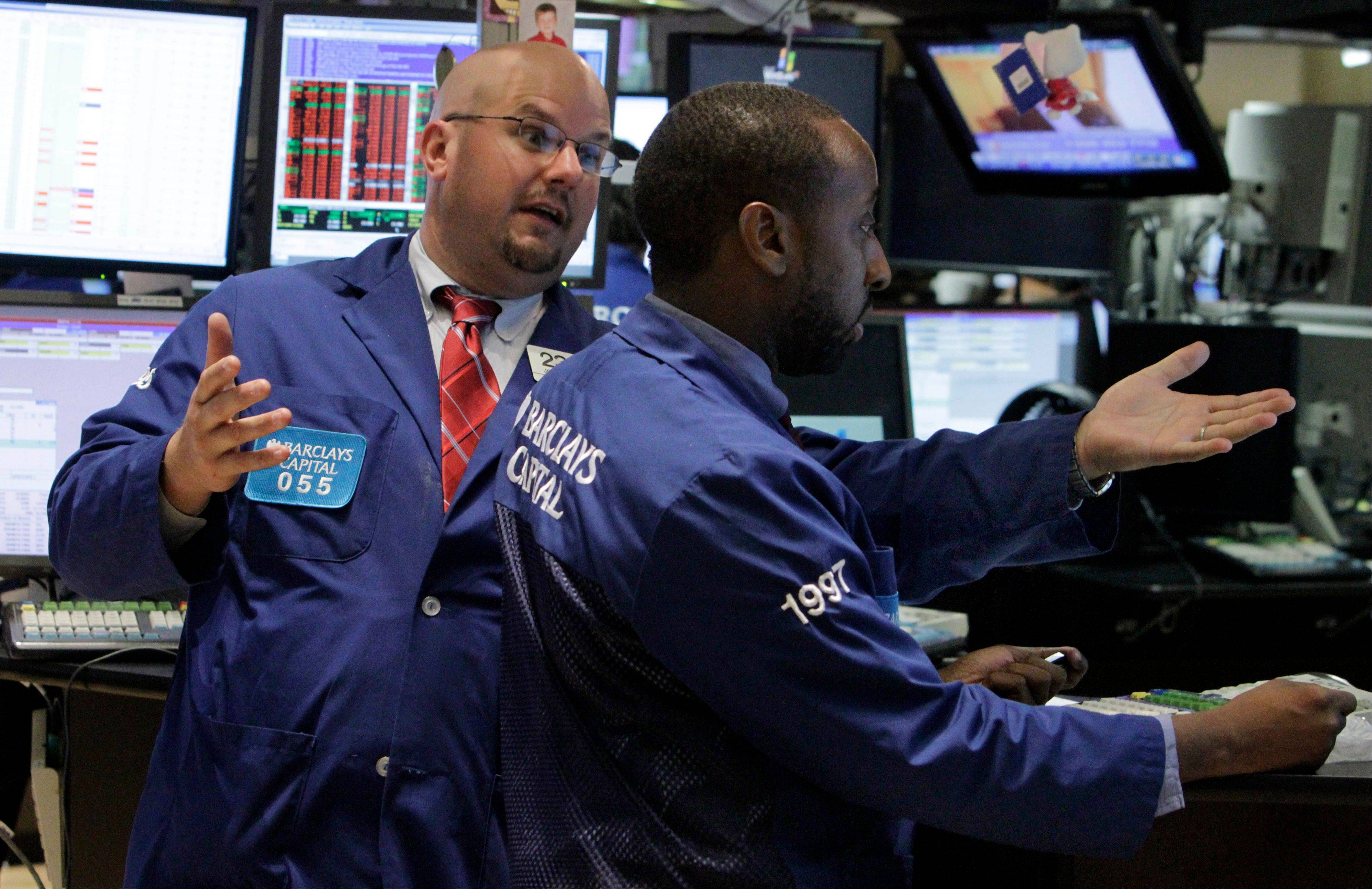 ASSOCIATED PRESSU.S. stocks fell, with benchmark indexes retreating from record highs, as concern grew that the Federal Reserve will scale back its stimulus efforts if the labor market continues to improve.