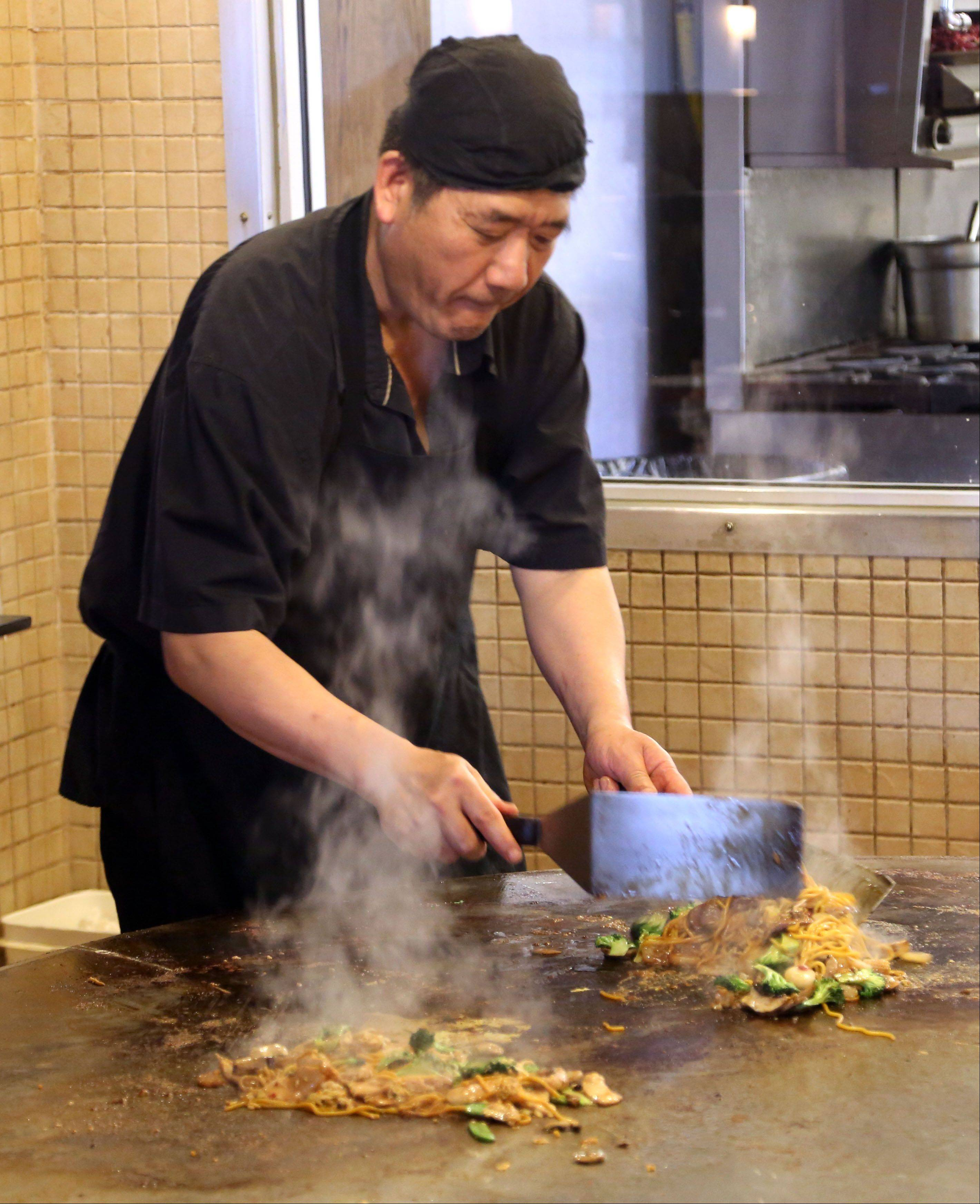Wu Du works the Mongolian grill at Kawa Japanese Restaurant and Mongolian Grill in Grayslake.