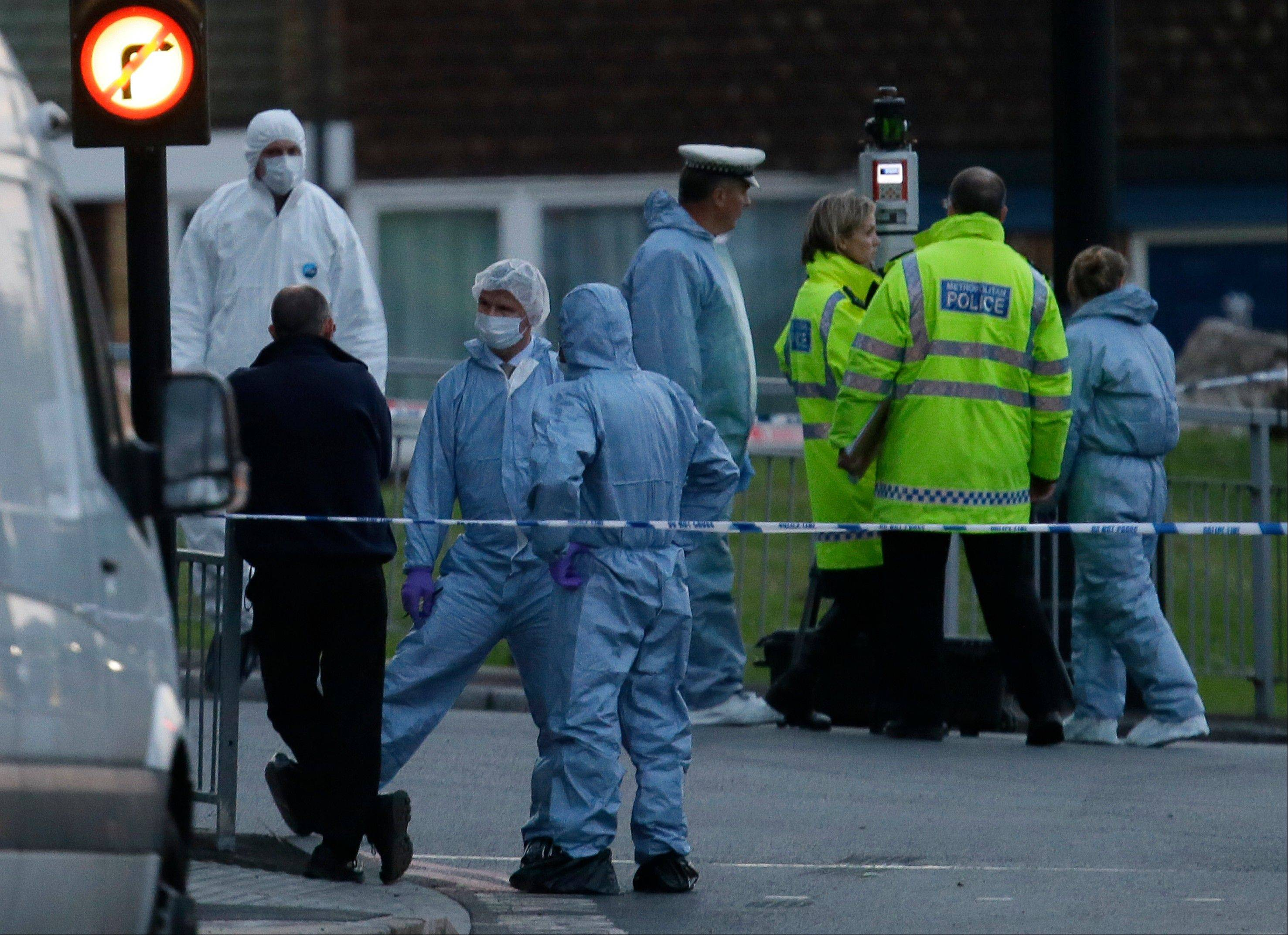 Police and forensic officers near the scene of an attack which has left one man confirmed dead and two people injured in London Wednesday.