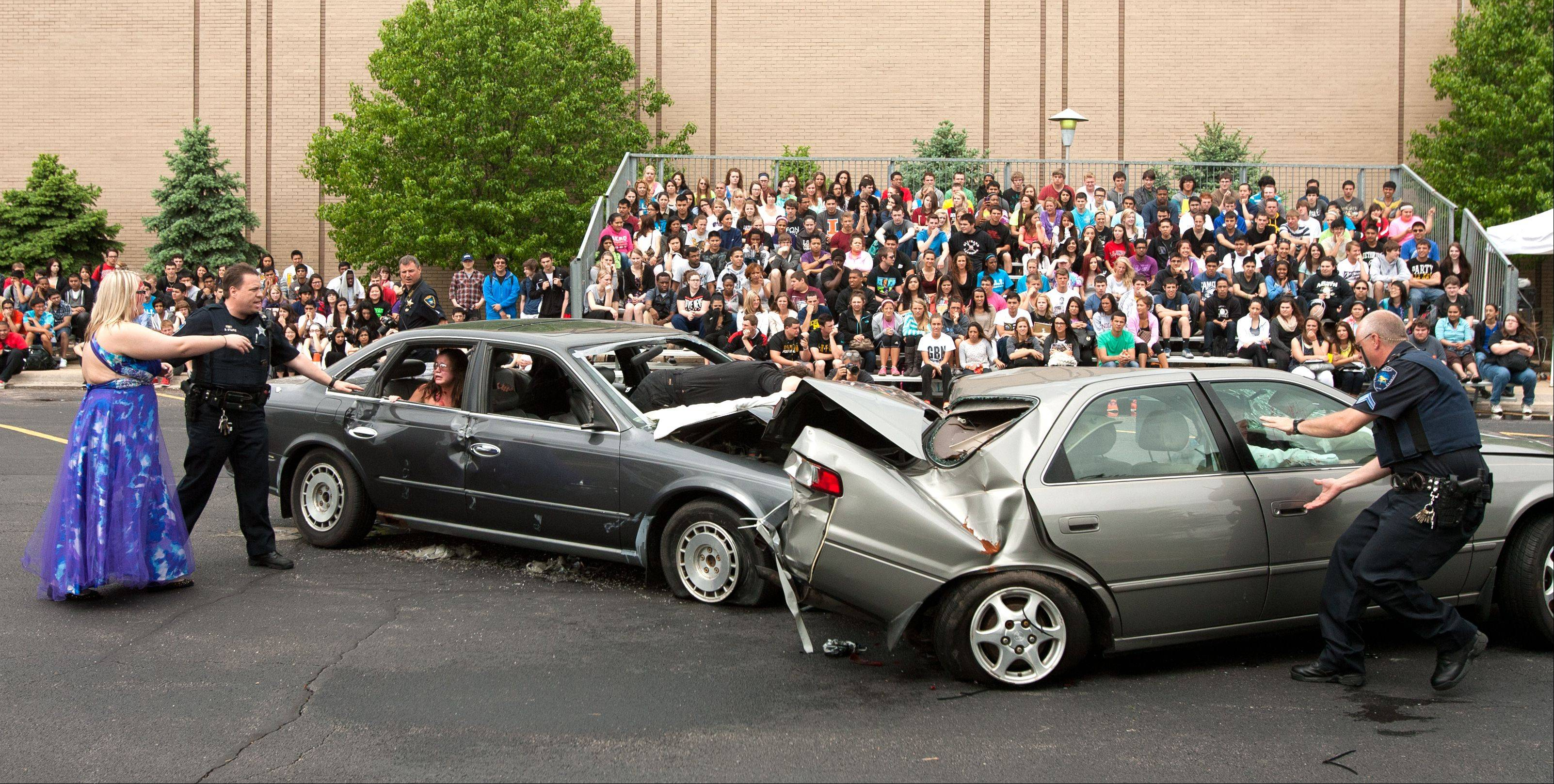 The Carol Stream Police Department and Carol Stream Fire Protection District stage a mock DUI fatal car crash Wednesday at Glenbard North High School.