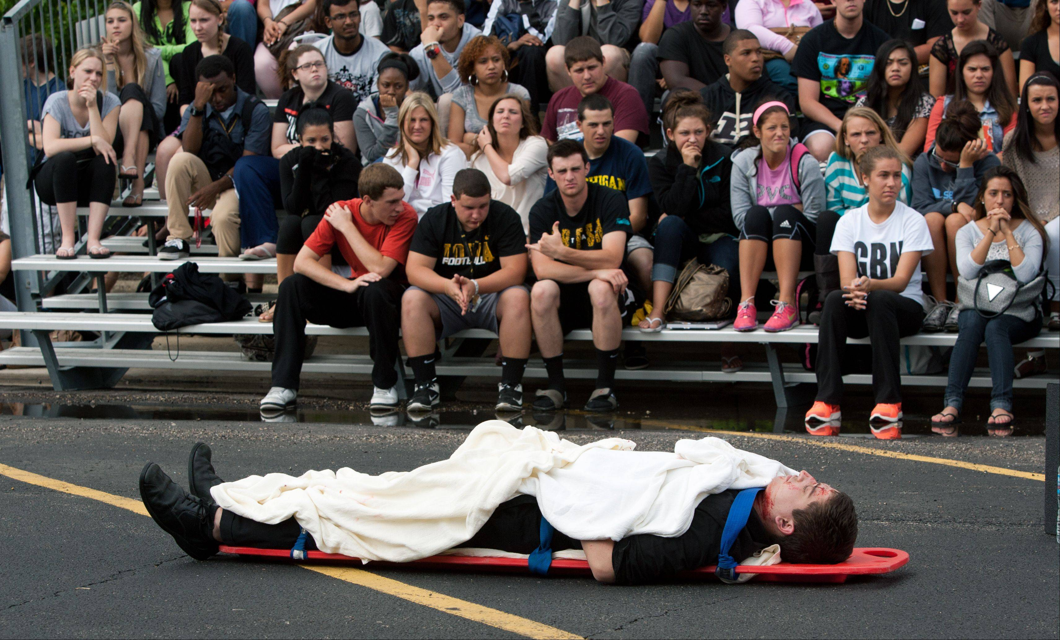 Students at Glenbard North High School watch a mock DUI fatal car crash demonstration, dubbed Operation Safe Celebration,Wednesday in advance of senior prom Saturday.