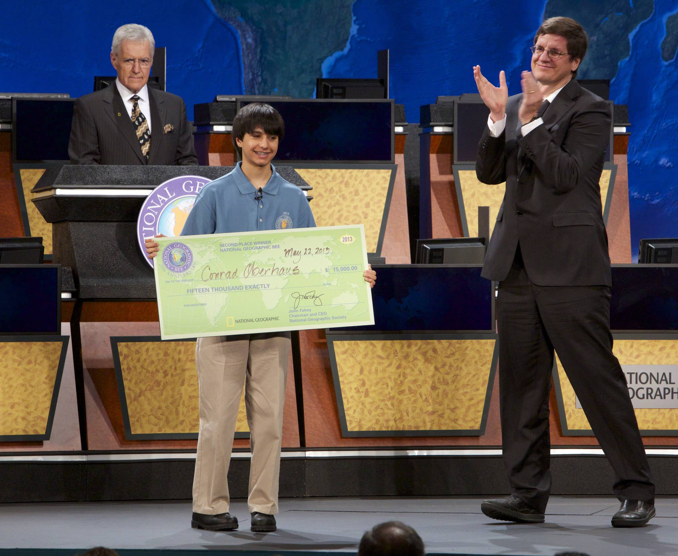 Alex Trebek, center, hosts the 2013 Geography Bee Finals on Wednesday at the National Theatre in Washington, D.C. Lake County's Conrad Oberhaus, right, competes with Sathwik Karnik.