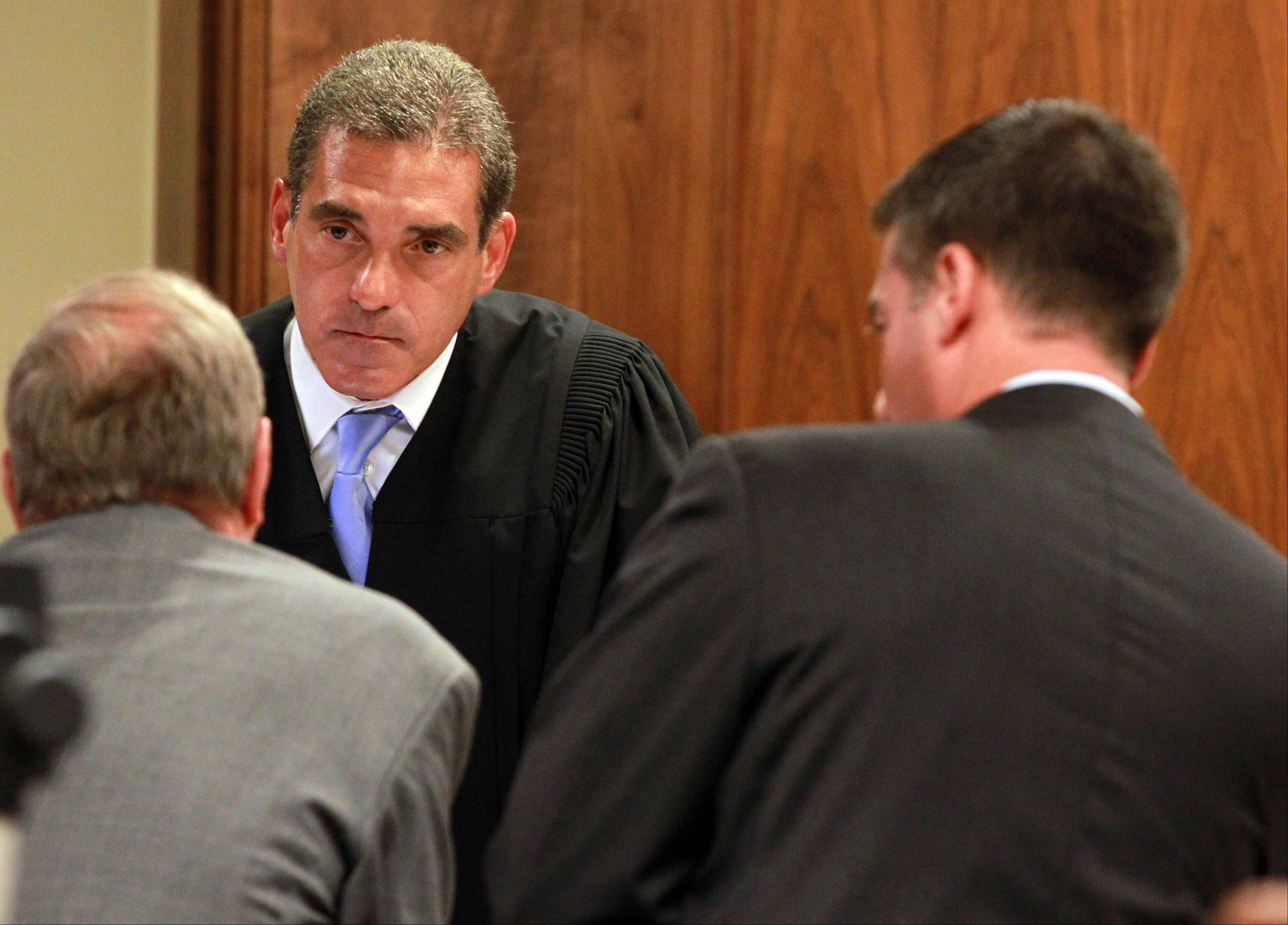 Lake County Judge Mark Levitt listens intently to the objections of defense attorneys during the murder trial of Ronald Stolberg in Waukegan on Wednesday.
