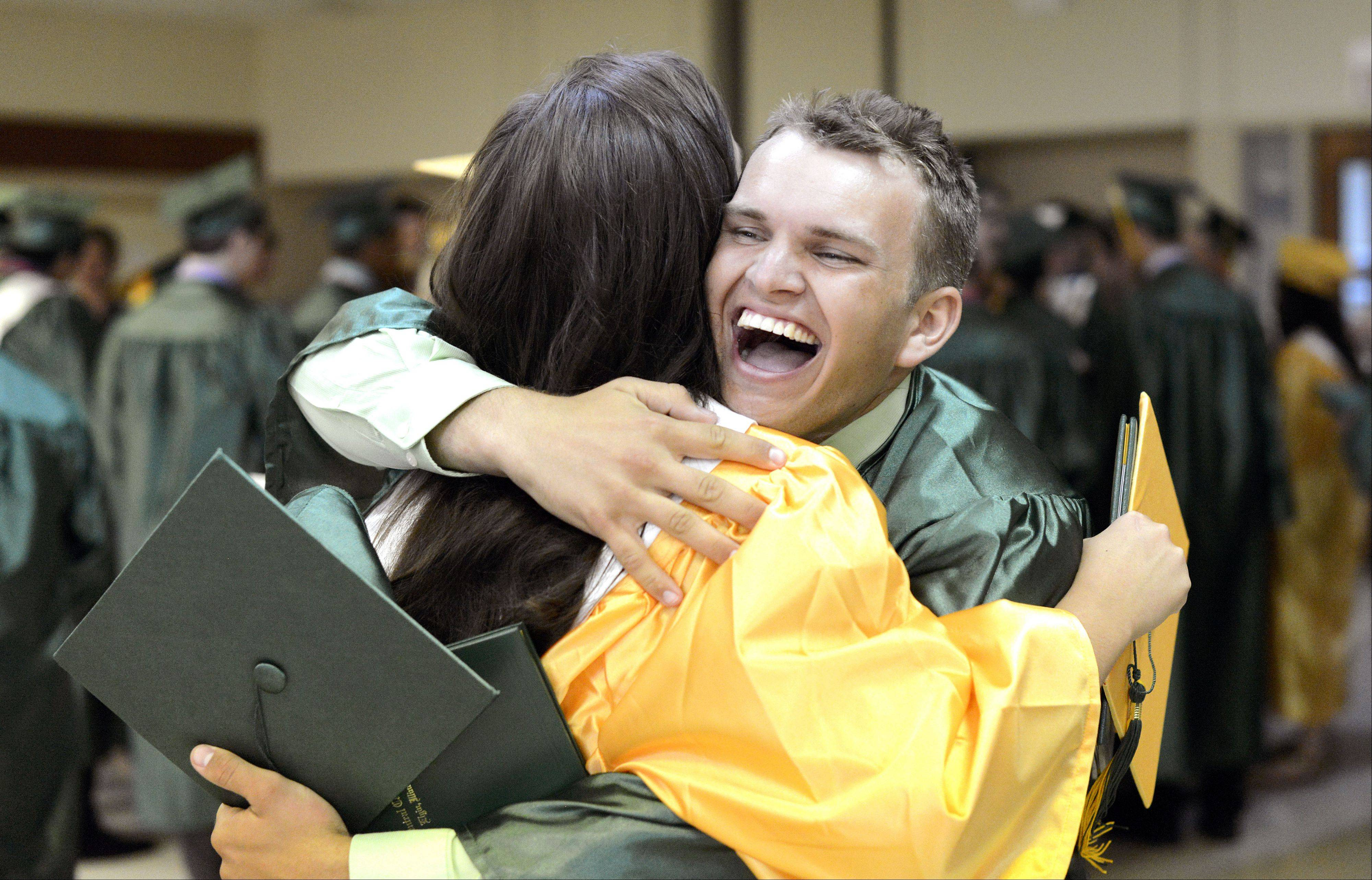 Sean McShane, 18, of Streamwood hugs fellow graduate Maris Worf, 18, of Elgin after their graduation ceremony.