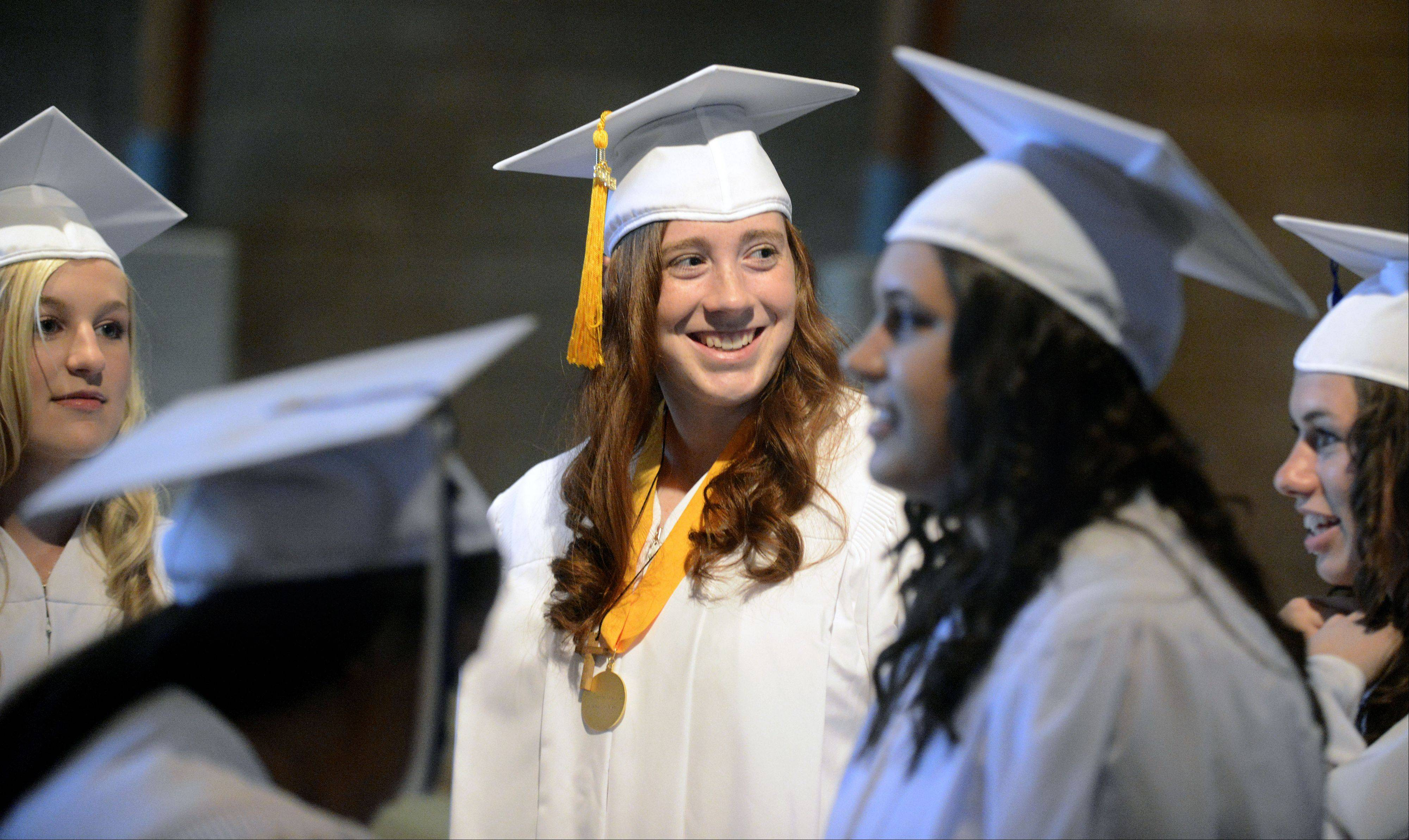 Jennifer Heweitt, 18, of Batavia, smiles as classmates have their photos taken .
