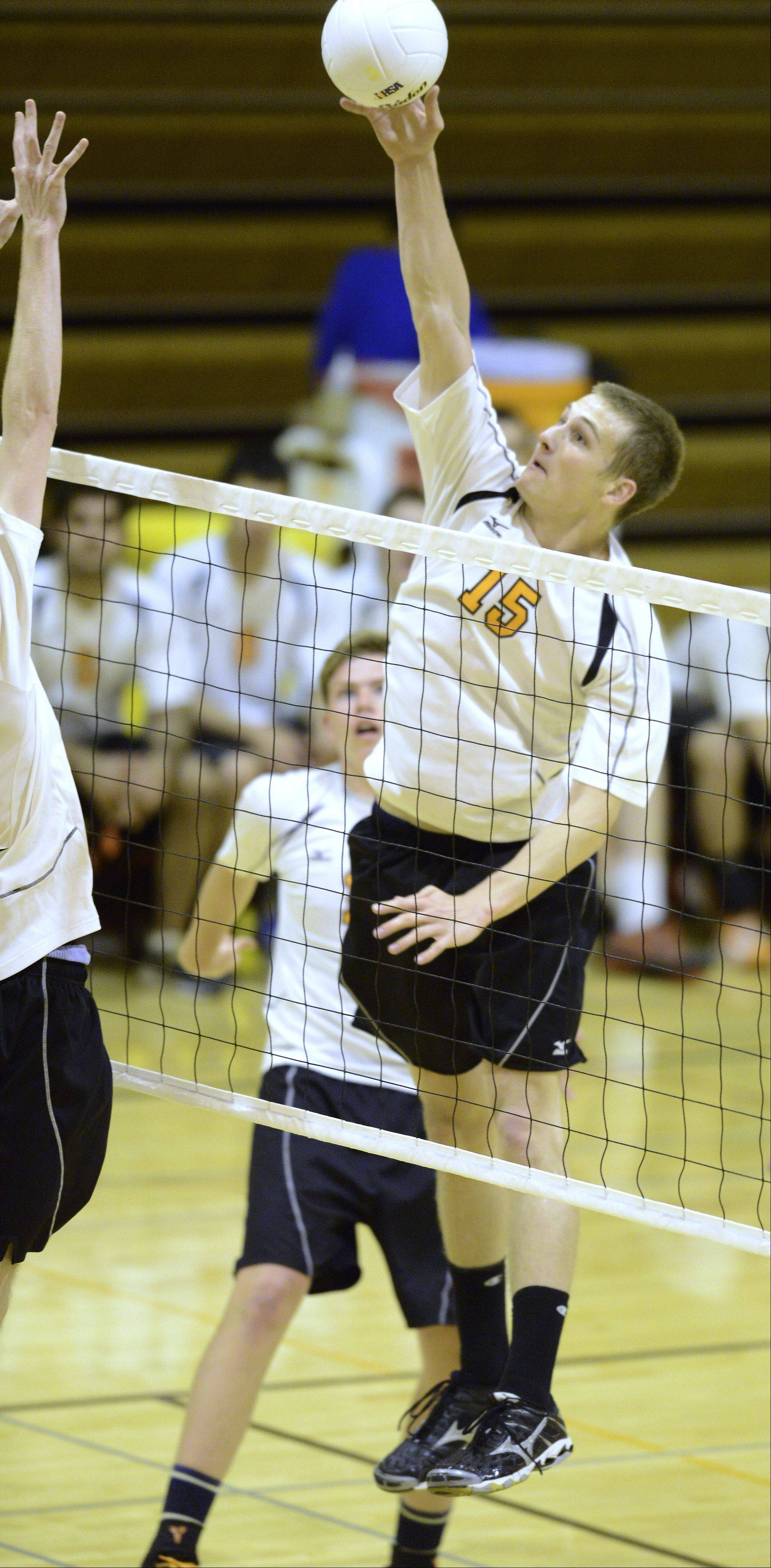 Hersey's Mike Fuerst leaps high for a kill during Wednesday's match against Glenbrook North in Arlington Heights.