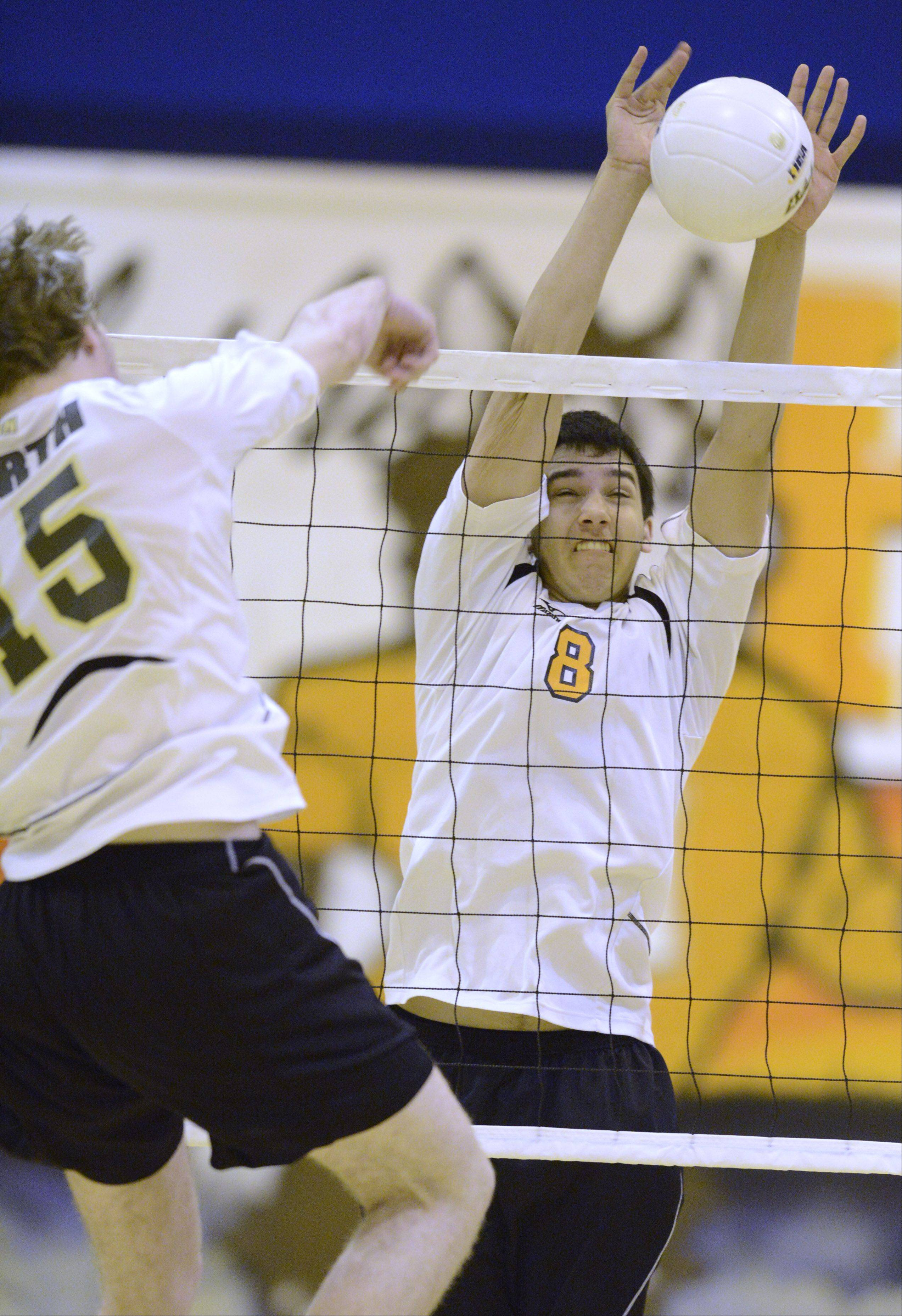 Hersey's Jordan Saeed, right, tries to block a ball hit by Glenbrook North's Rob Chatterton during Wednesday's match in Arlington Heights.