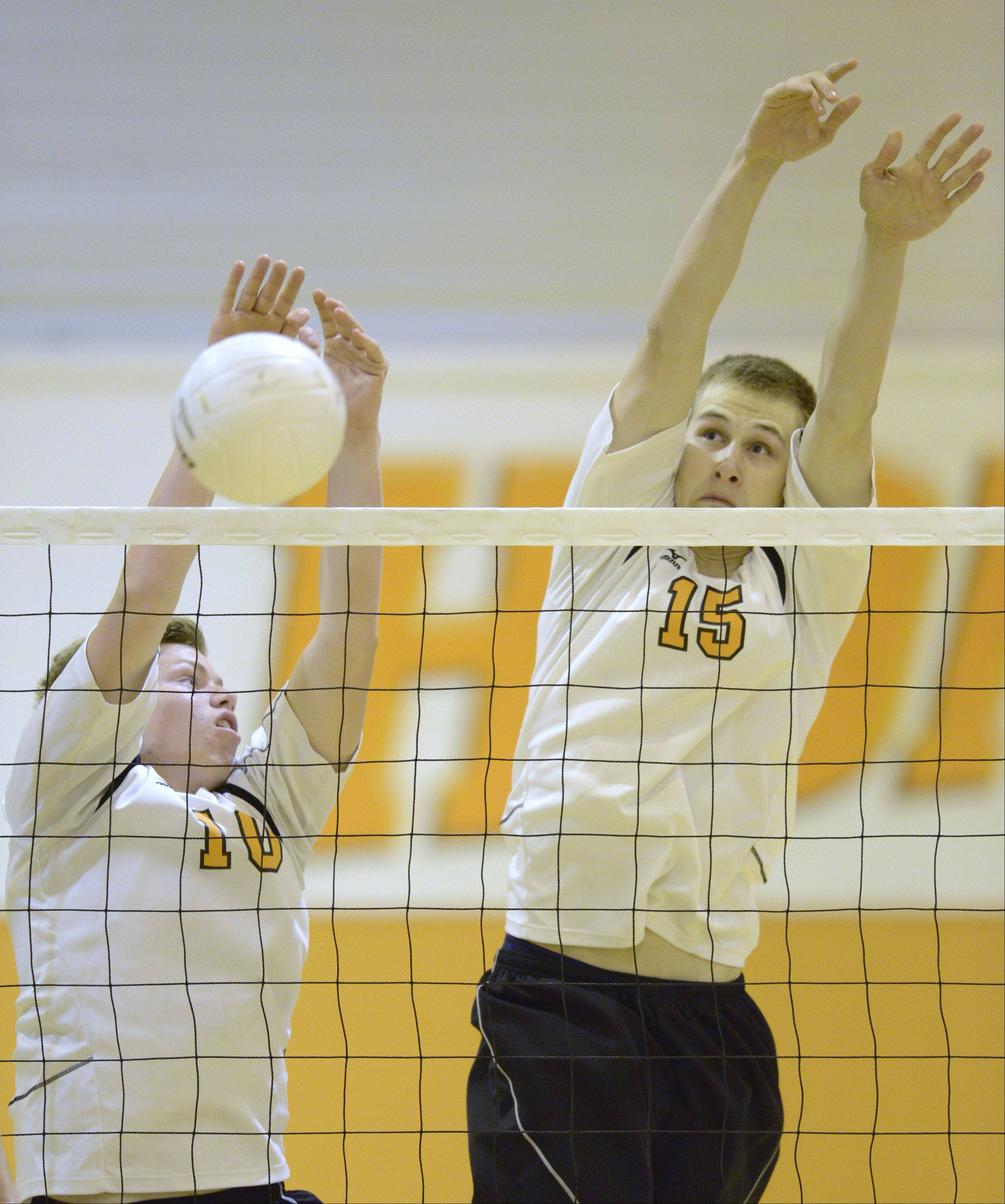 Hersey's Matt Torvik, left, and Mike Fuerst leap for a block at the net during Wednesday's match against Glenbrook North in Arlington Heights.