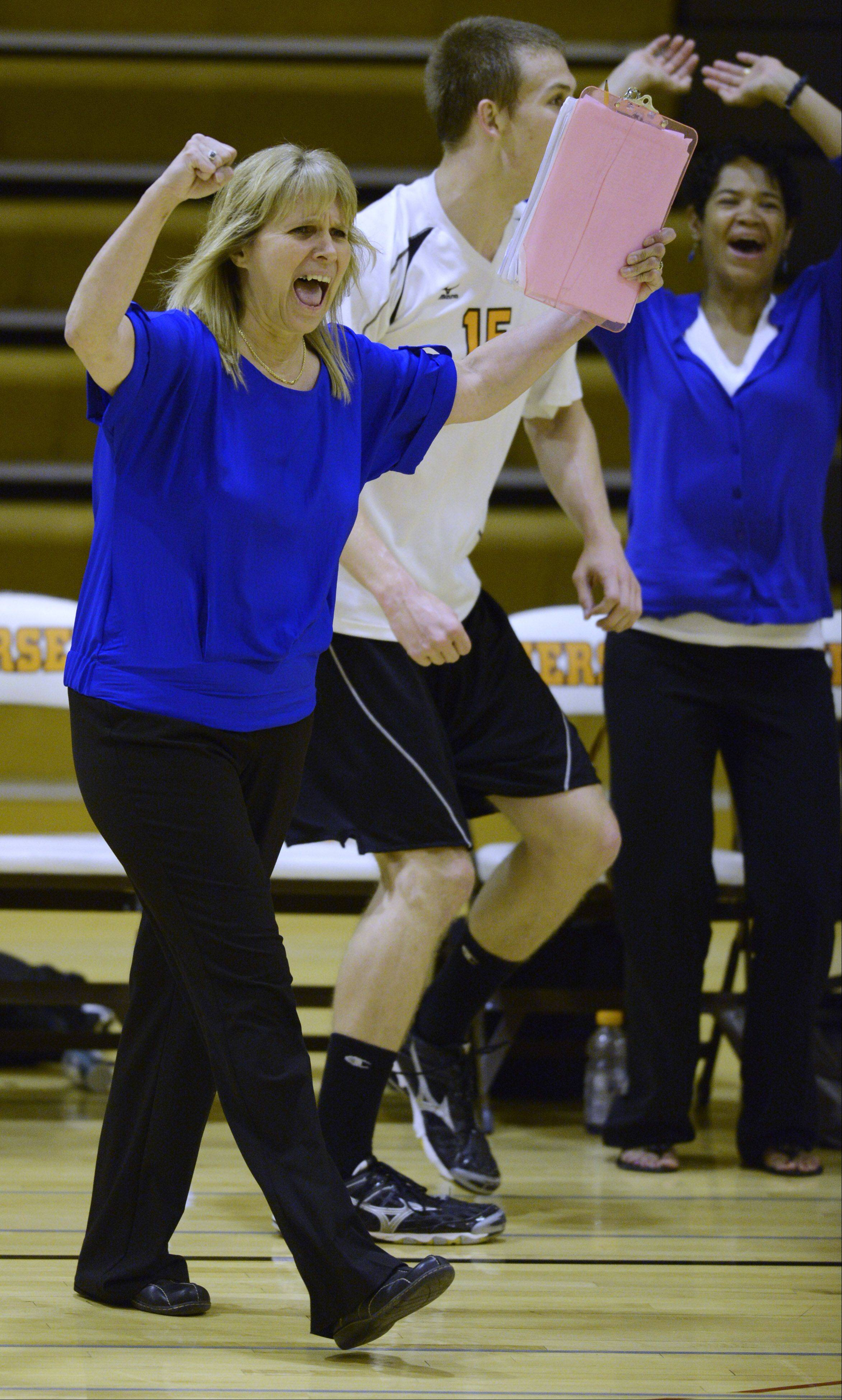 Hersey boys volleyball coach Nancy Lill celebrates a hard-fought point by her team during Wednesday's match against Glenbrook North in Arlington Heights.