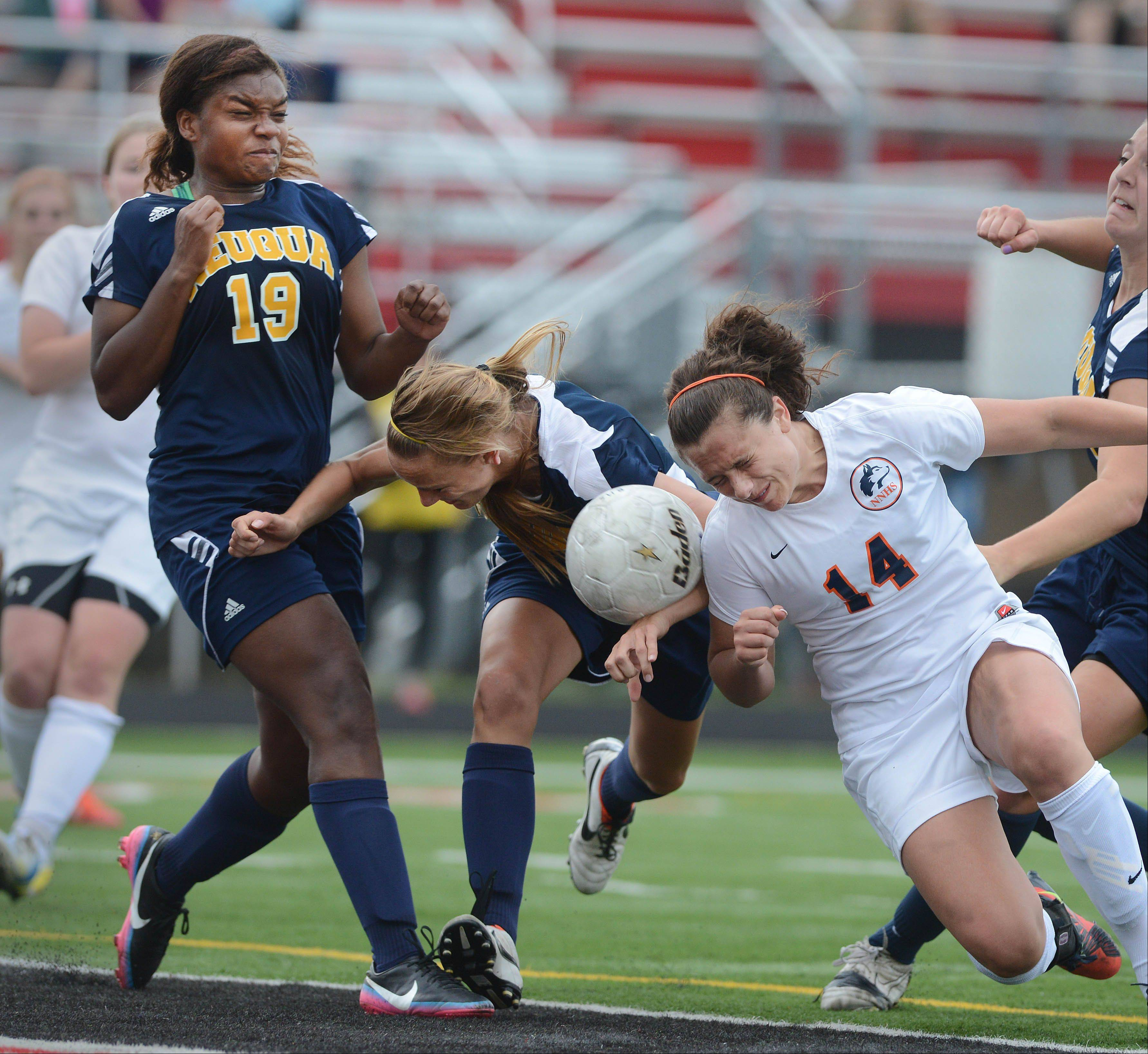 Dannah Williams,left, Gianna Dal Pozzo of Neuqua Valley move in on Christa Szalach of Naperville North during the Class 4A Bolingbrook girls soccer semifinals Wednesday.