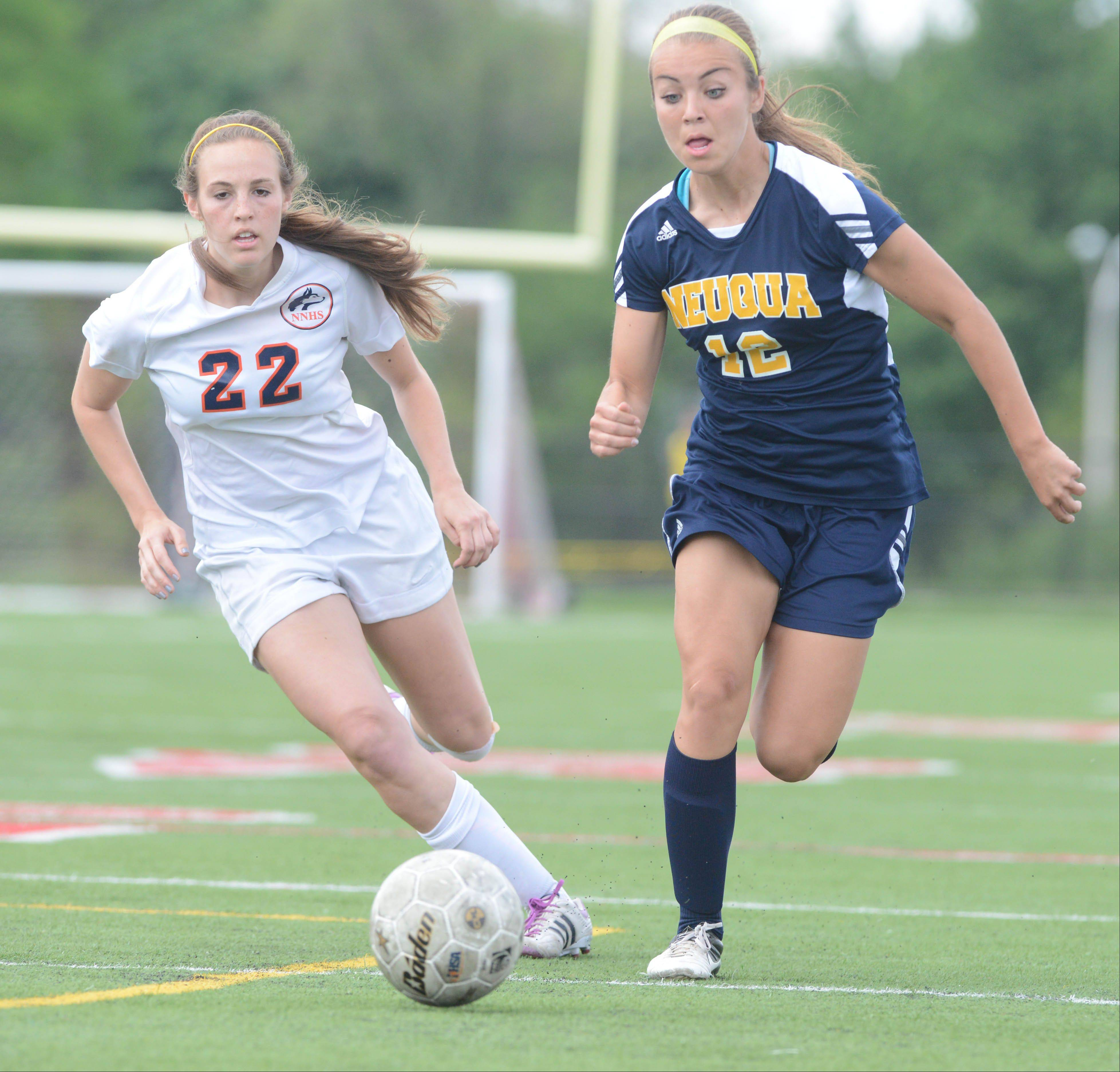 Tracy Korn of Naperville North,left, and Lauren Ciesla of Neuqua move the ball during the Class 4A Bolingbrook girls soccer semifinals Wednesday.