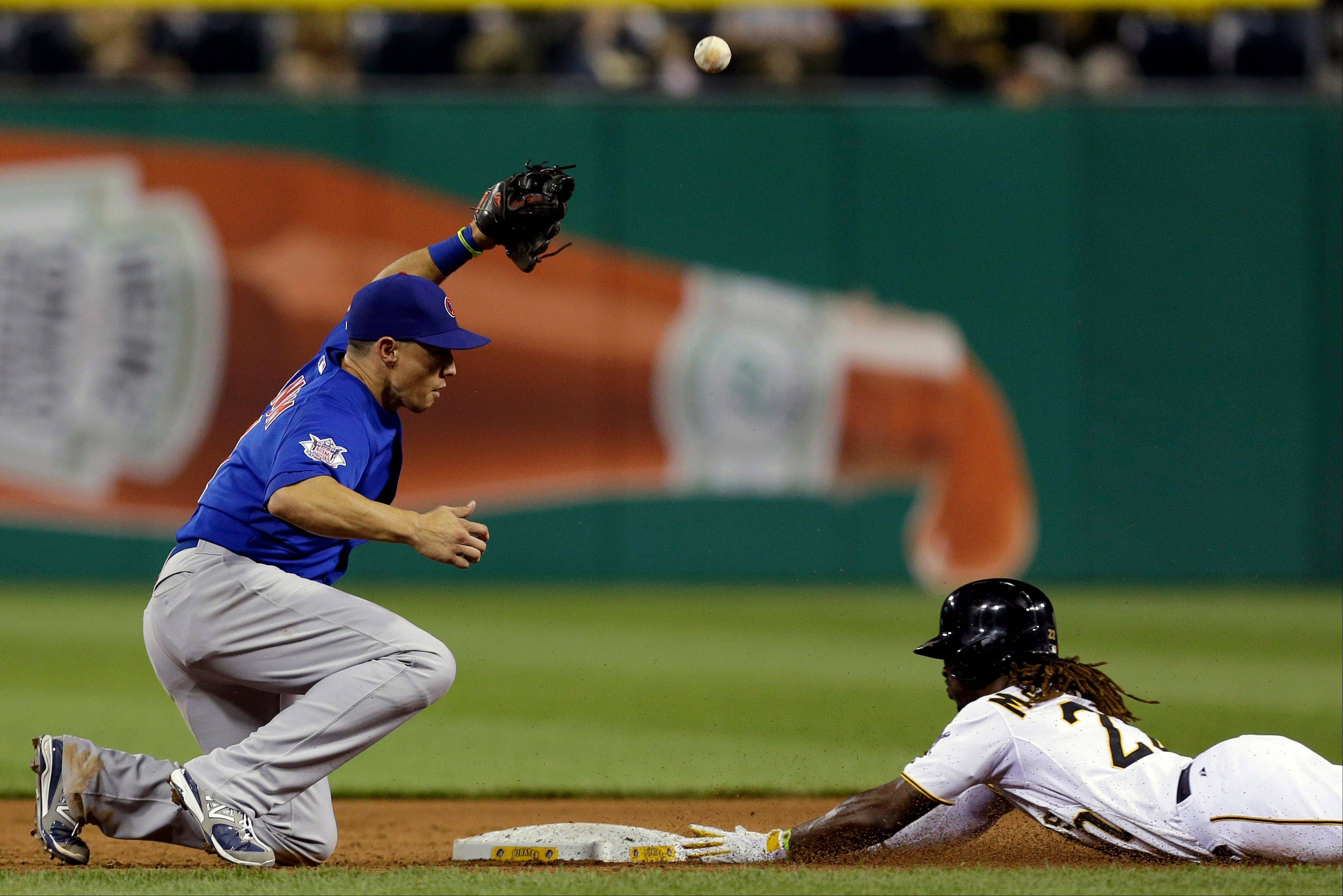 Pittsburgh Pirates' Andrew McCutchen, right, steals second as the throw from Chicago Cubs catcher Welington Castillo gets away from Cubs' Cody Ransom, left, during the Wednesday's game in Pittsburgh. The Cubs lost 1-0.