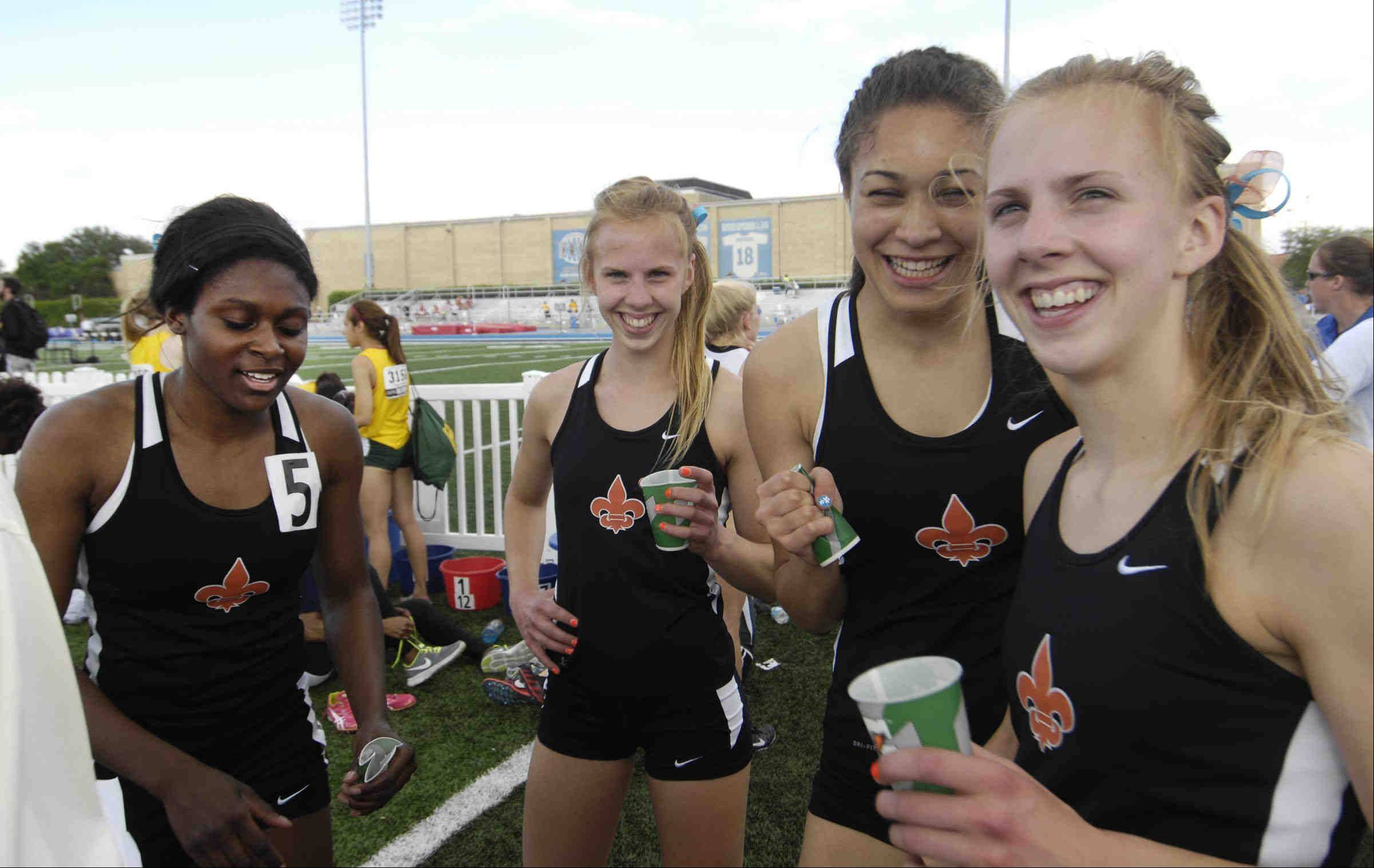 St. Charles East's Britney Williams, left, Allison Chmelik, Jordan Shead, and Elizabeth Chmelik, right, celebrate their 1,600 meter relay win Saturday at the Class 3A girls state track and field finals at O'Brien Stadium at Eastern Illinois University in Charleston.