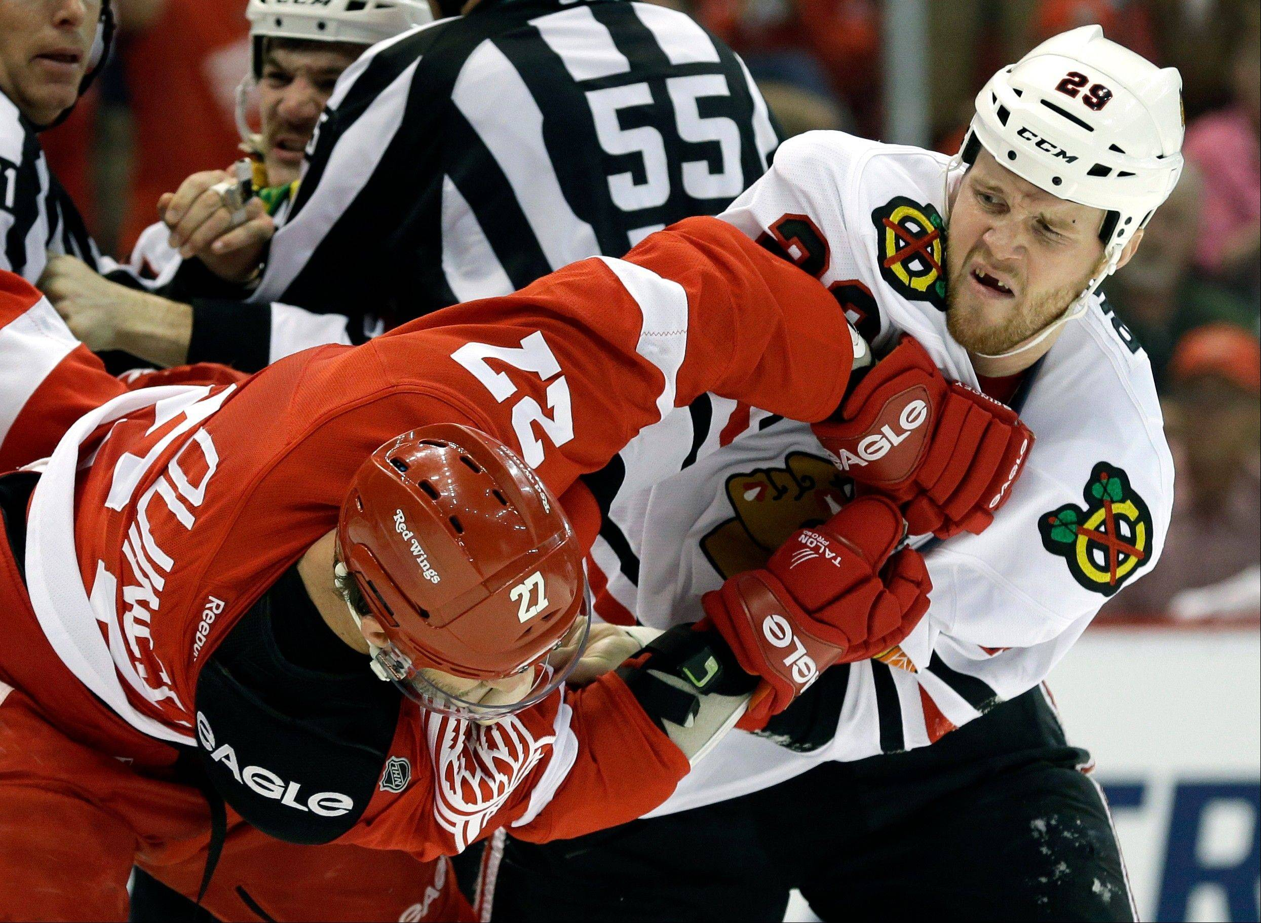 Some of the fiesty play in Game 3 could spill into Game 4 when the Red Wings host the Blackhawks in Detroit. Kyle Quincey (27) and Blackhawks left wing Bryan Bickell (29) had some words in the first period of Detroit's Game 3 win.