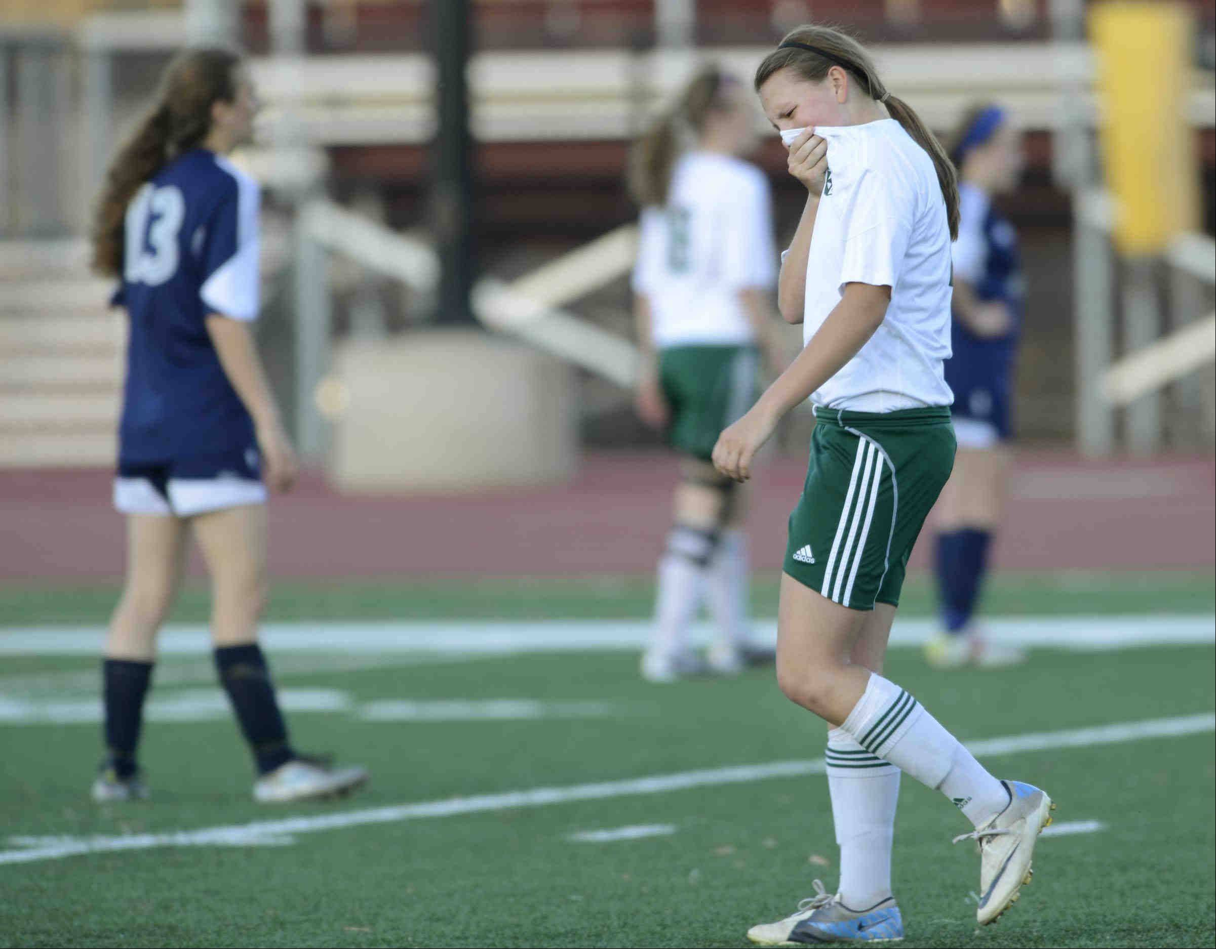 St. Edward's Allison Kruk begins to react to the Green Wave's 3-1 loss to Francis W. Parker with seconds left Tuesday in the supersectional playoff at Concordia University in River Forest.
