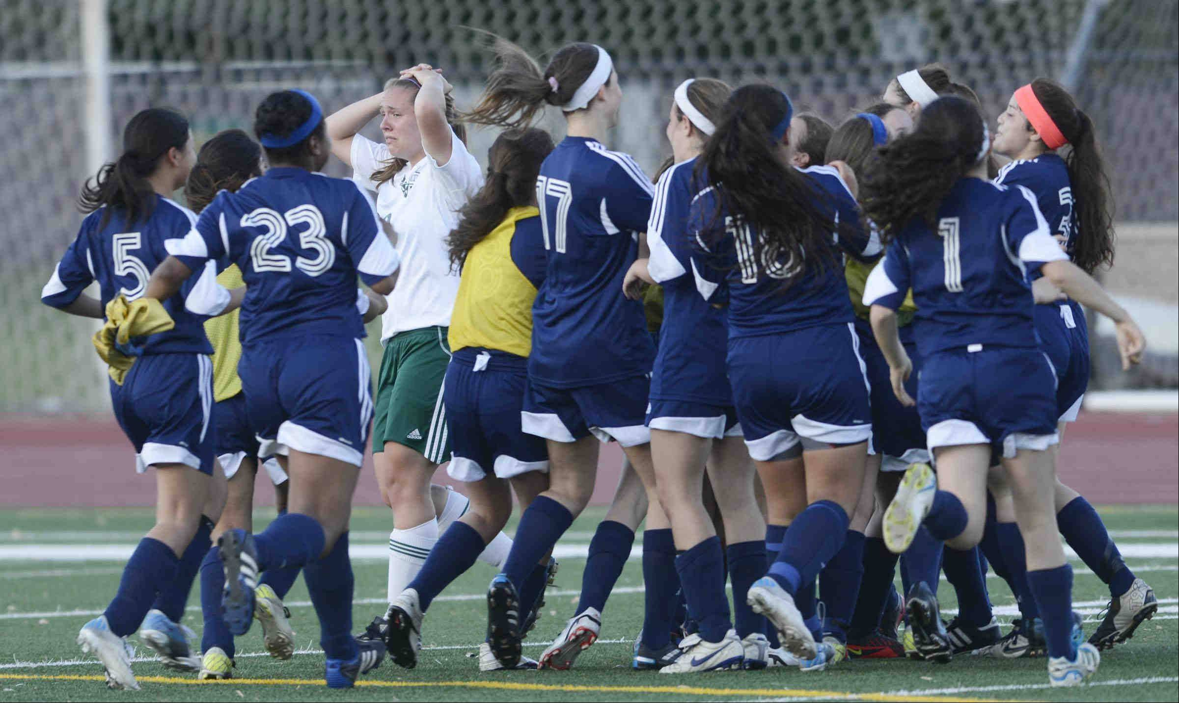 St. Edward's Meagan Kearney walks away with her hands on her head as Francis W. Parker players celebrate their 3-1 win Tuesday in the supersectional playoff at Concordia University in River Forest. Kearney scored the only Green Wave goal.