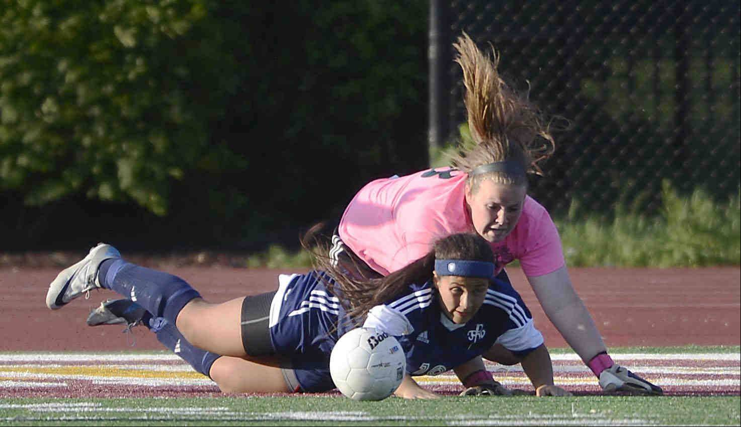St. Edward goalkeeper Paige Dykstra and Francis W. Parker's Julia Turner fall to the turf Tuesday in the supersectional playoff at Concordia University in River Forest.