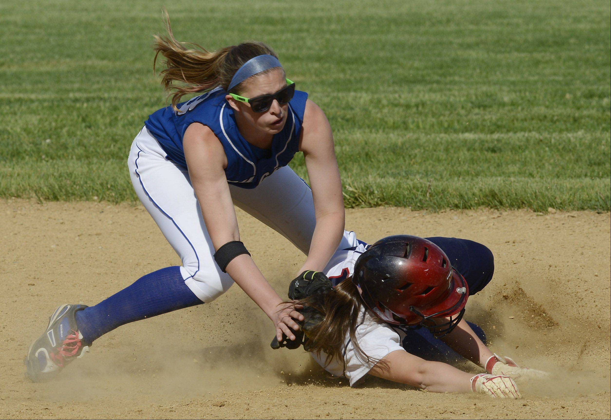 Vernon Hills' Dana Meline tags out St. Viator's Gina Mastrodomenico on a steal attempt during Tuesday's regional semifinal in Arlington Heights.