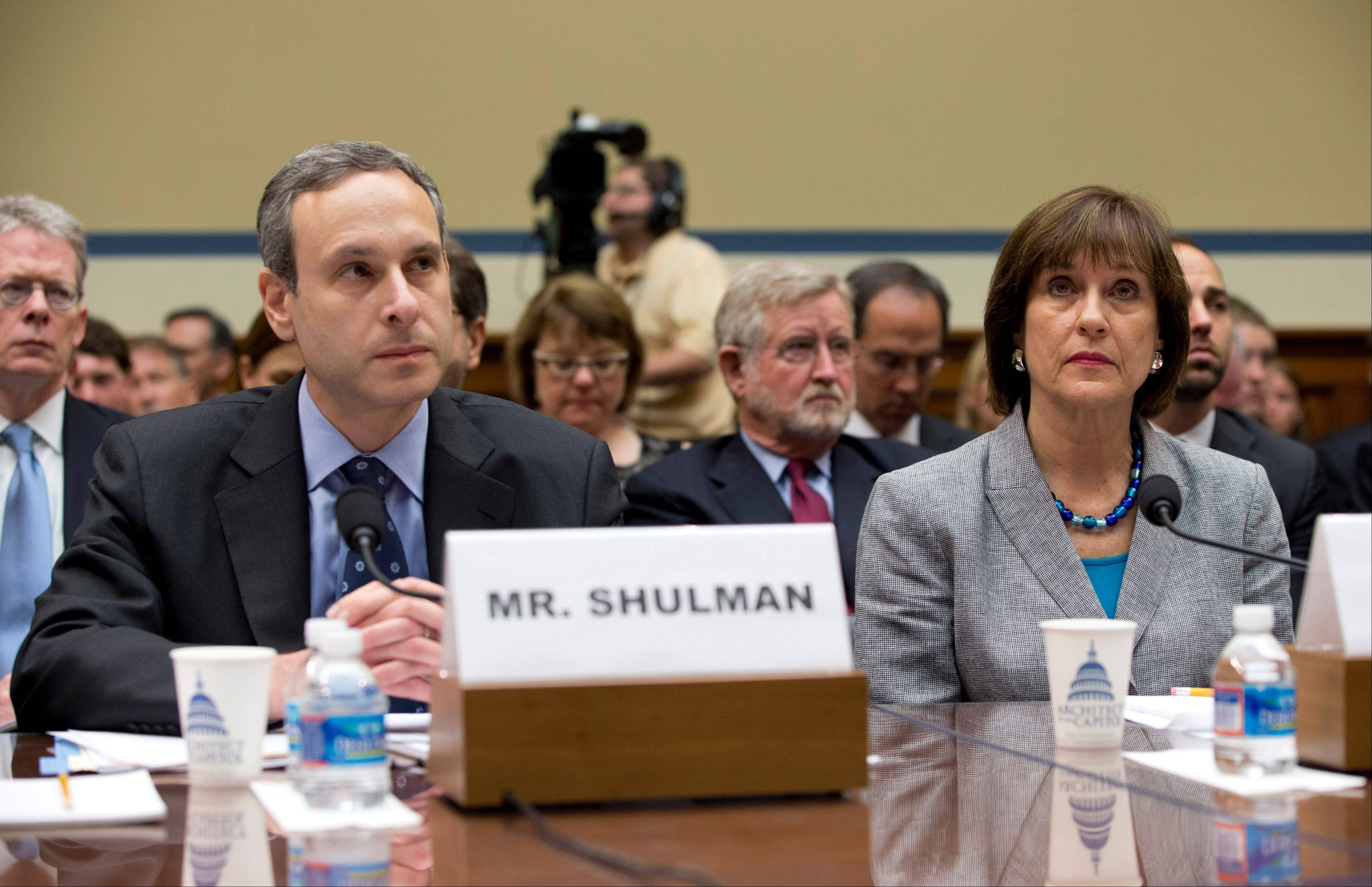 IRS official Lois Lerner, right, and former IRS Commissioner Douglas Shulman sit Wednesday at the witness table on Capitol Hill in Washington, prior to the start of a House Oversight and Government Reform Committee hearing.