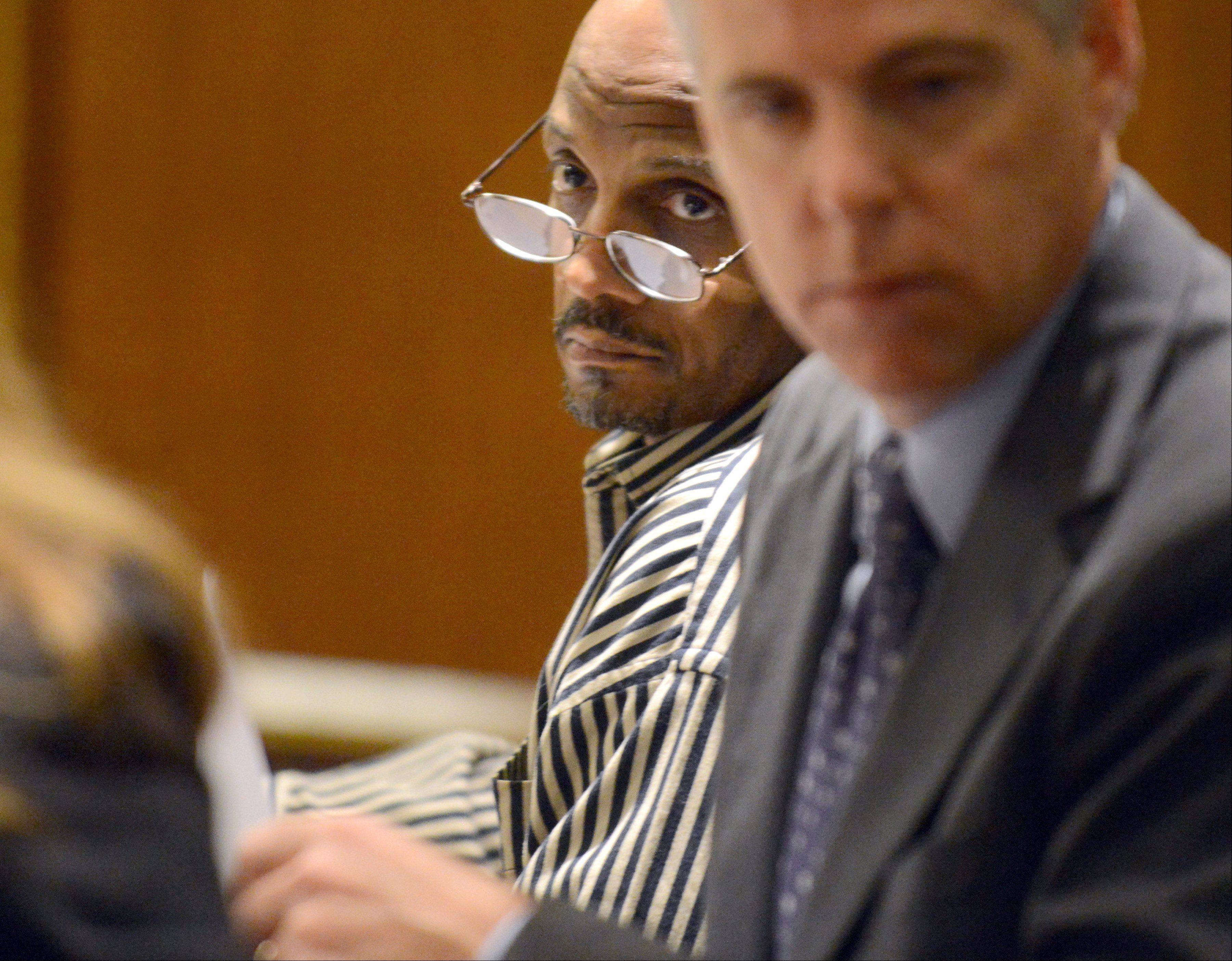 James Ealy, 48, of Lake Villa looks to his attorney, Assistant Public Defender Keith Grant, during his trial Thursday.