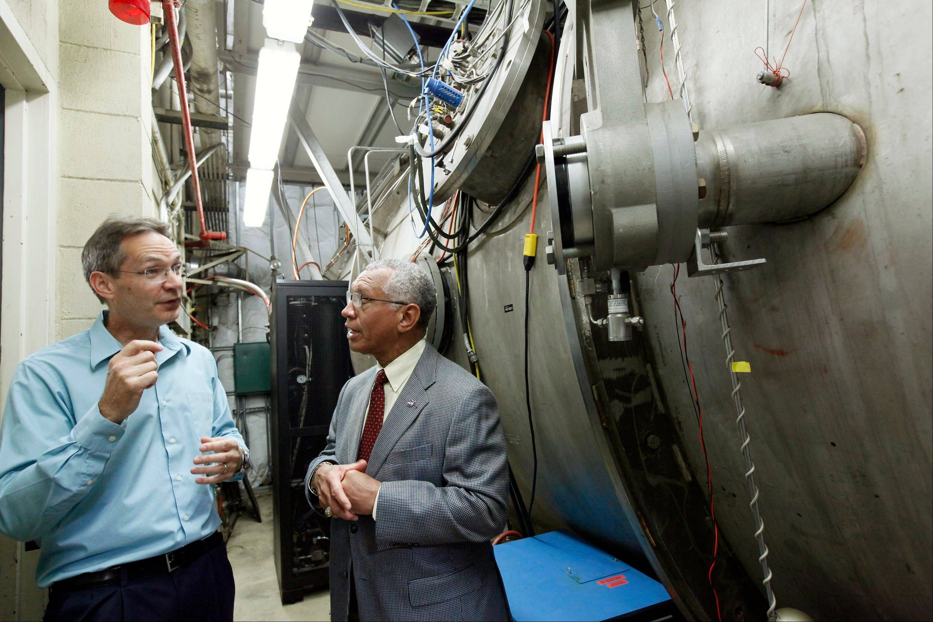 NASA Administrator Charles Bolden, right, talks with electric propulsion engineer John Brophy during a Thursday visit to Nasa's Jet Propulsion Laboratory in Pasadena, Calif.