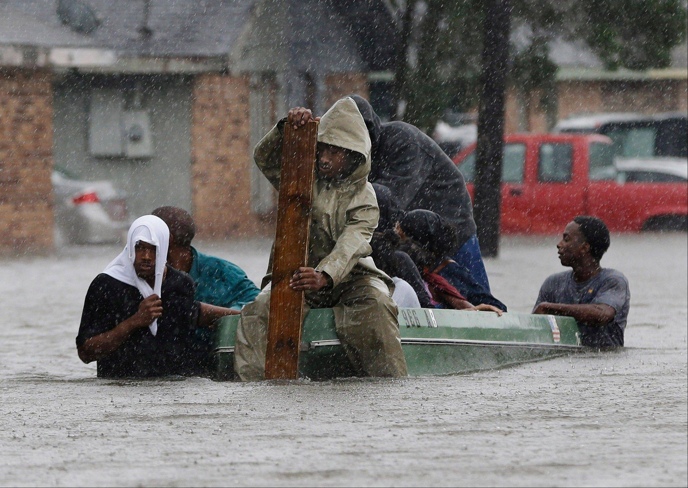 Residents evacuate their flooded neighborhood in LaPlace, La. during Hurricane Isaac. Federal forecasters are predicting yet another busy hurricane season with 13 to 20 named storms.