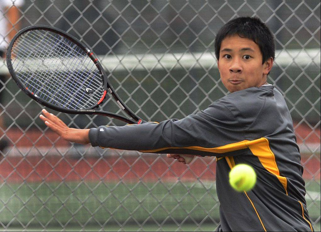 Kendrich Chong of Jacobs competes at the state boys tennis tournament Thursday.
