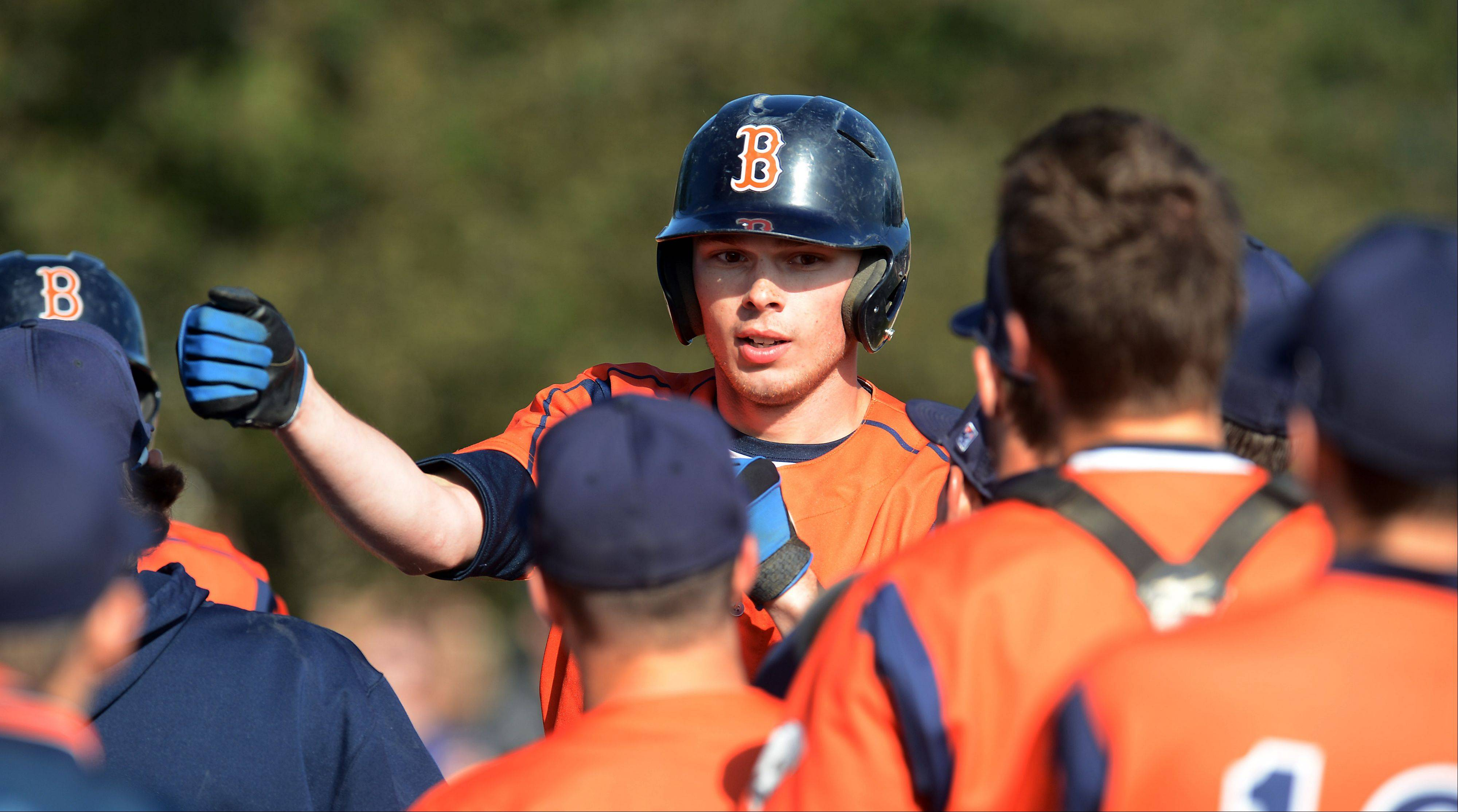 Buffalo Grove�s Josh Guertler is met at home plate after his fourth inning homer against Mundelein during the Bison�s 11-9 victory Thursday at St. Viator.