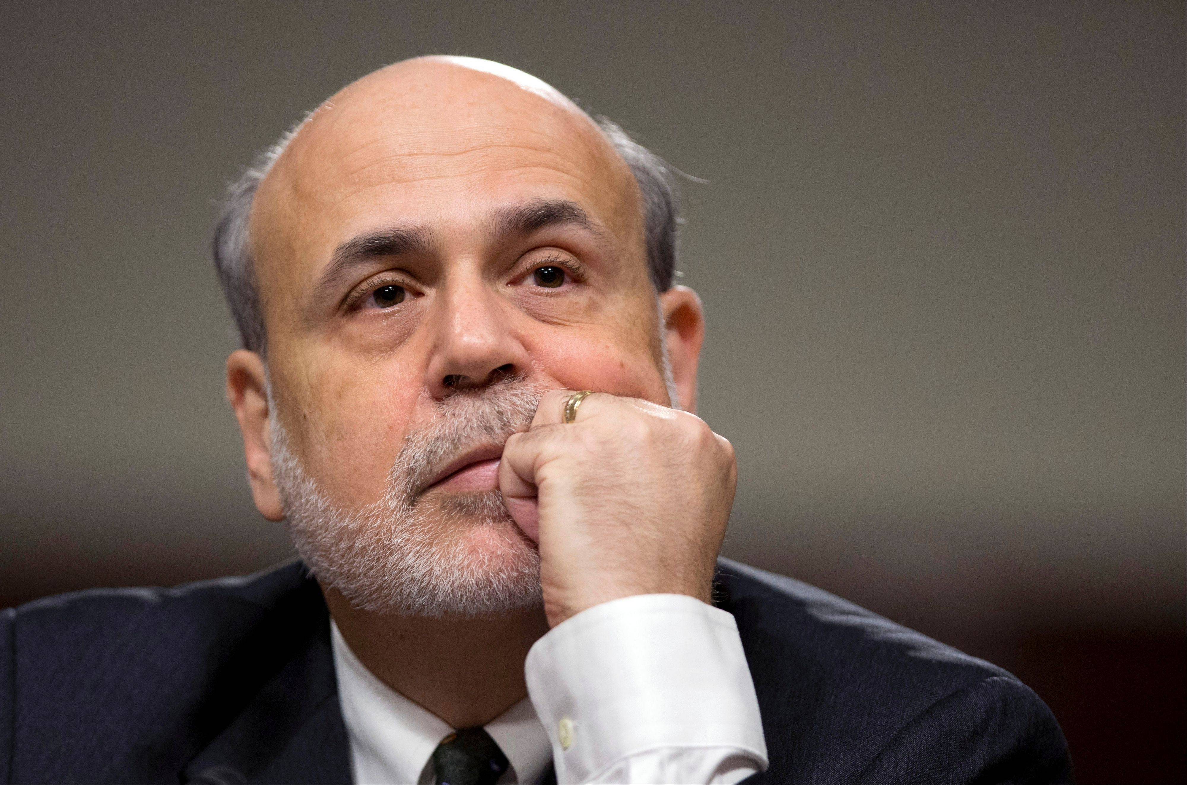 "Federal Reserve Chairman Ben Bernanke listens as he testifies Wednesday on Capitol Hill in Washington, before a Senate Joint Economic Committee hearing on ""The Economic Outlook."""