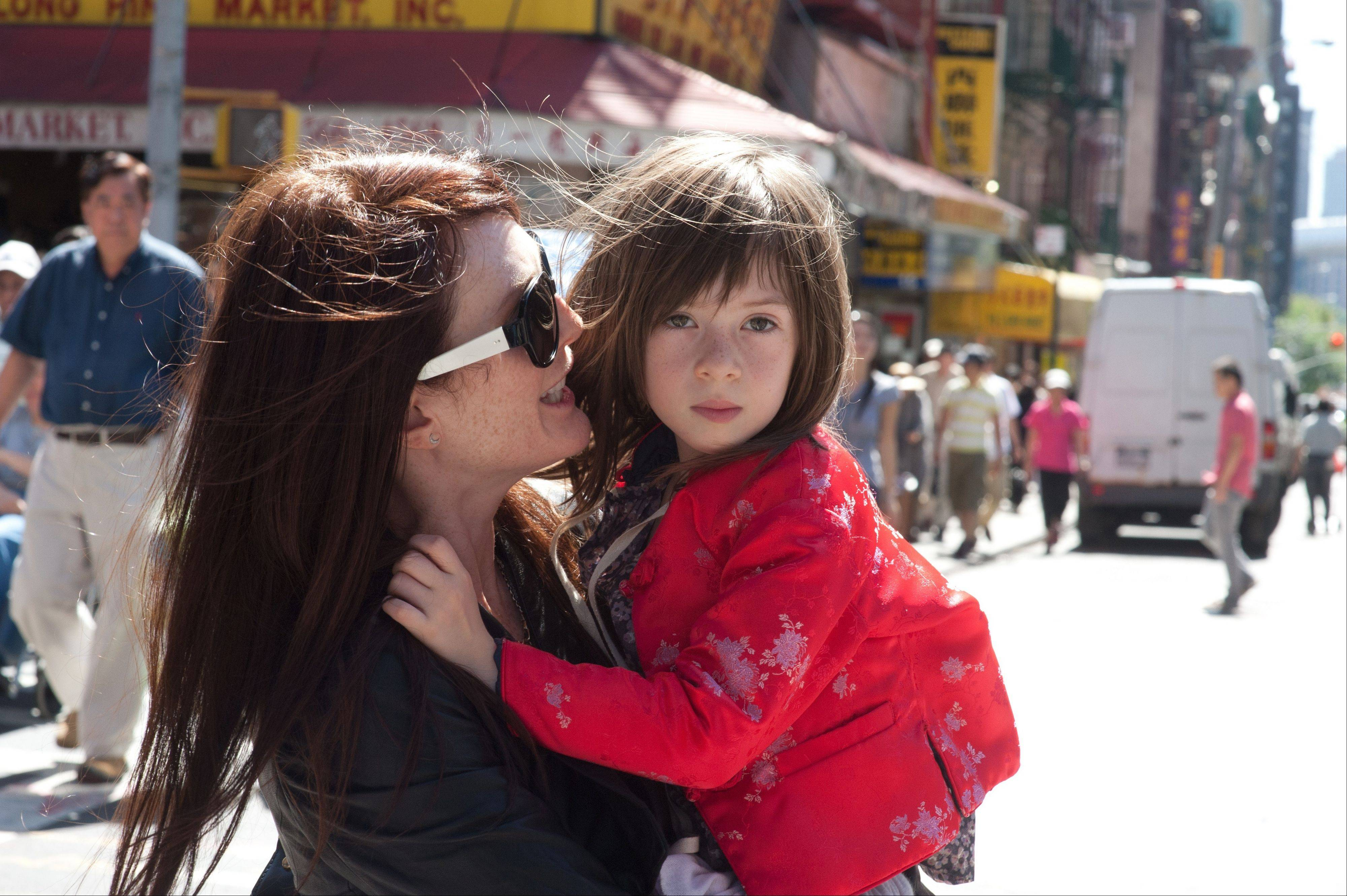 "Self-absorbed Susanna (Julianne Moore) spends time with her 6-year-old daughter Maisie (Onata Aprile) in ""What Maisie Knew."""