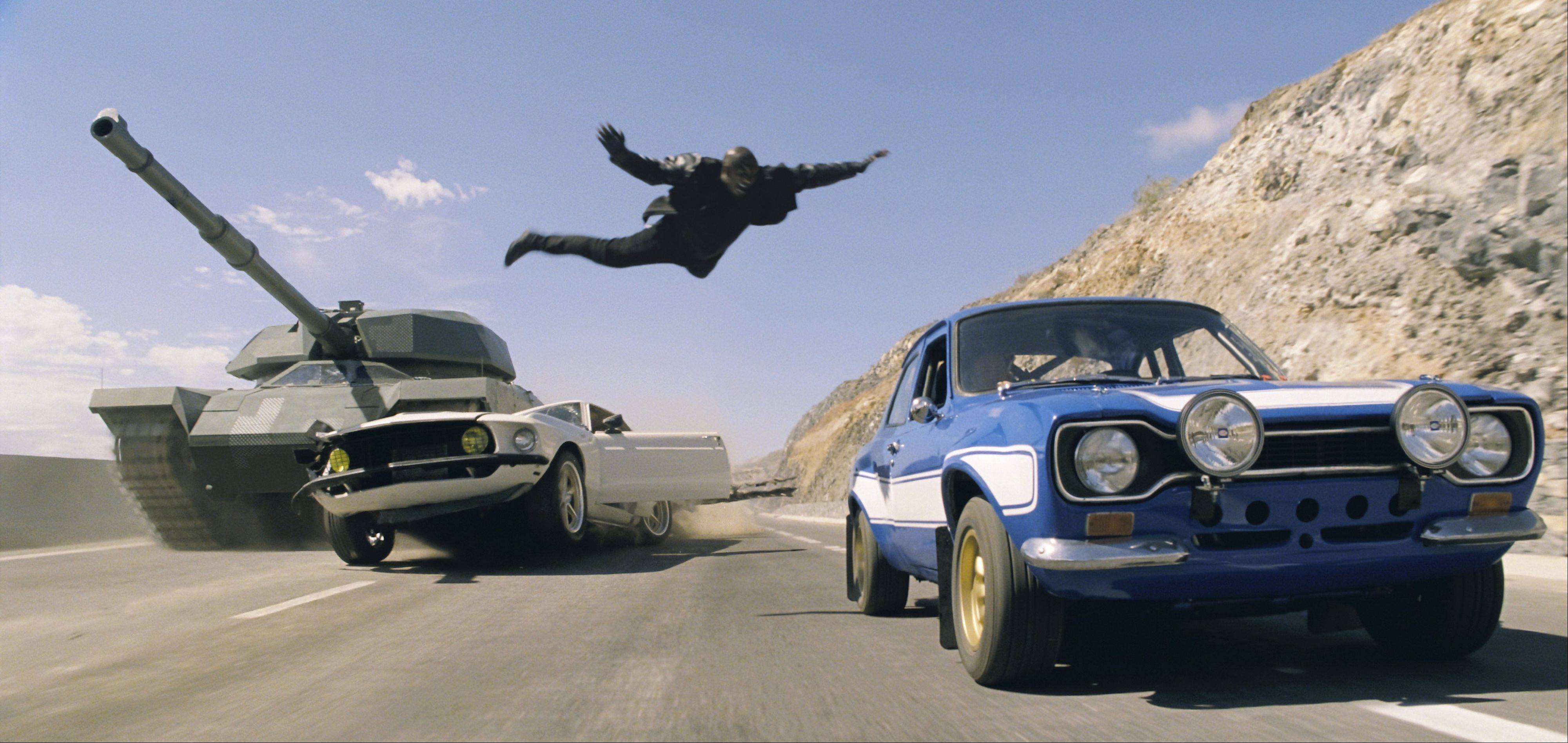 "Roman (Tyrese Gibson, or at least his stunt double) escapes being crushed by a military tank in Justin Lin's thrill-packed ""Fast & Furious 6."""