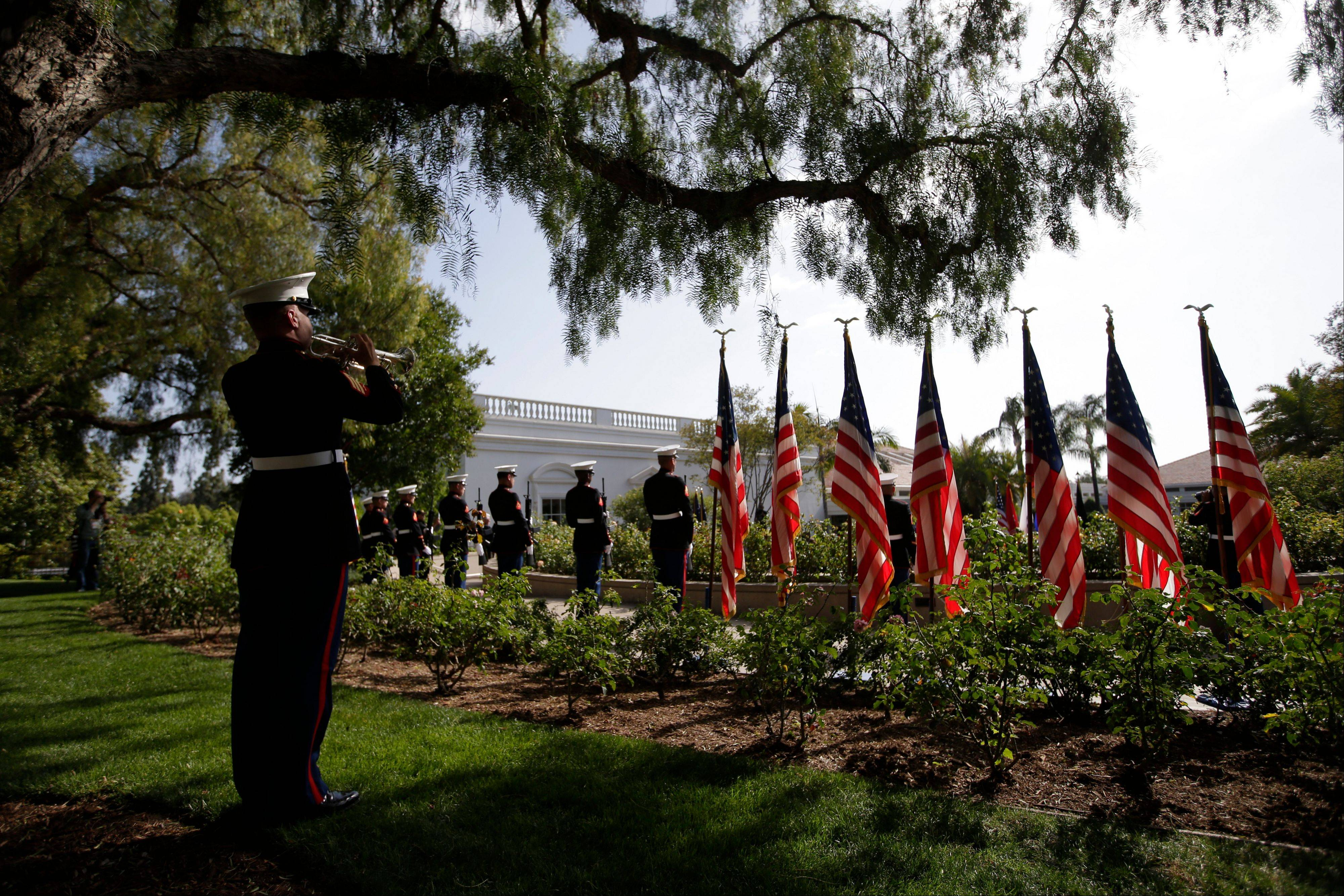 Marine Sgt. John Finch, left, plays the trumpet during the 40th reunion for Vietnam POWs at the Richard Nixon Presidential Library & Museum in Yorba Linda, Calif.