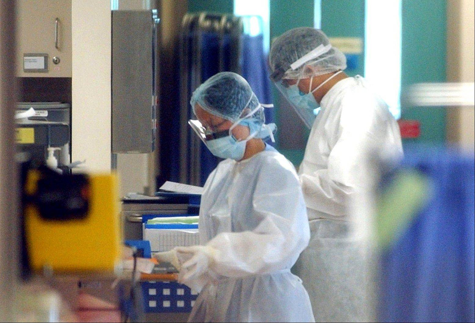 Health workers wear protective gear in the Alice Ho Miu Ling Nethersole Hospital in Hong Kong where 24 patients were quarantined after seven of its health workers developed SARS, flu-like symptoms similar to the Coronavirus. A coronavirus infection related to SARS, which killed about 800 people in 2003, mostly in Asia, is now being reported mainly in the Middle East. T