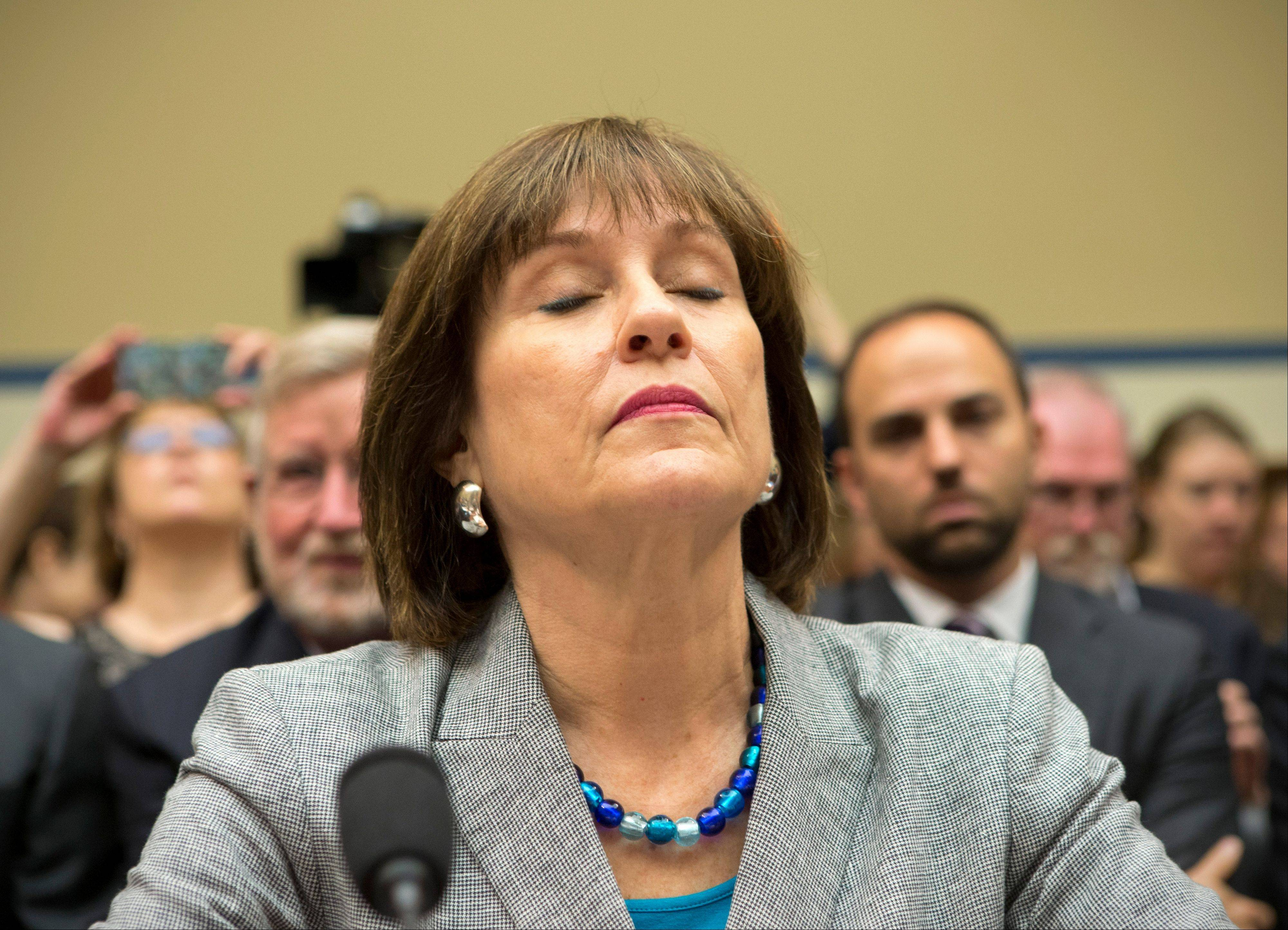Lois Lerner, head of the IRS unit that decides whether to grant tax-exempt status to groups, listens on Capitol Hill in Washington, Wednesday, May 22, 2013, during a House Oversight and Government Reform Committee hearing to investigate the extra scrutiny the IRS gave to Tea Party and other conservative groups that applied for tax-exempt status. Lerner later invoked her constitutional right to not answer questions and was dismissed by House Oversight Committee Chairman Darrell Issa, R-Calif.