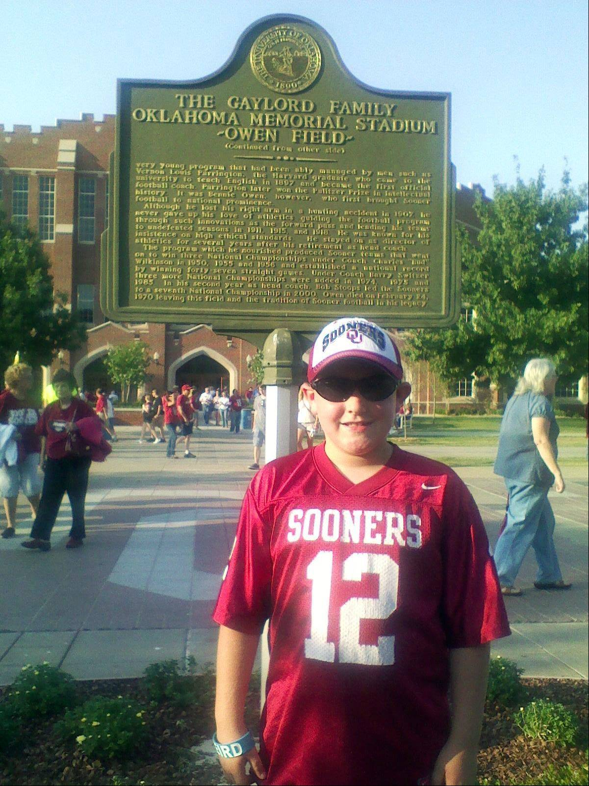 Eight-year-old tornado victim Kyle Davis poses for a photo while attending an Oklahoma University football game at Owen Field, in Norman, Okla. Kyle was killed Monday, May 20, 2013, when a huge tornado roared through Moore, Okla., flattening entire neighborhoods and destroying Kyle's elementary school with a direct blow as children and teachers huddled against winds up to 200 mph.