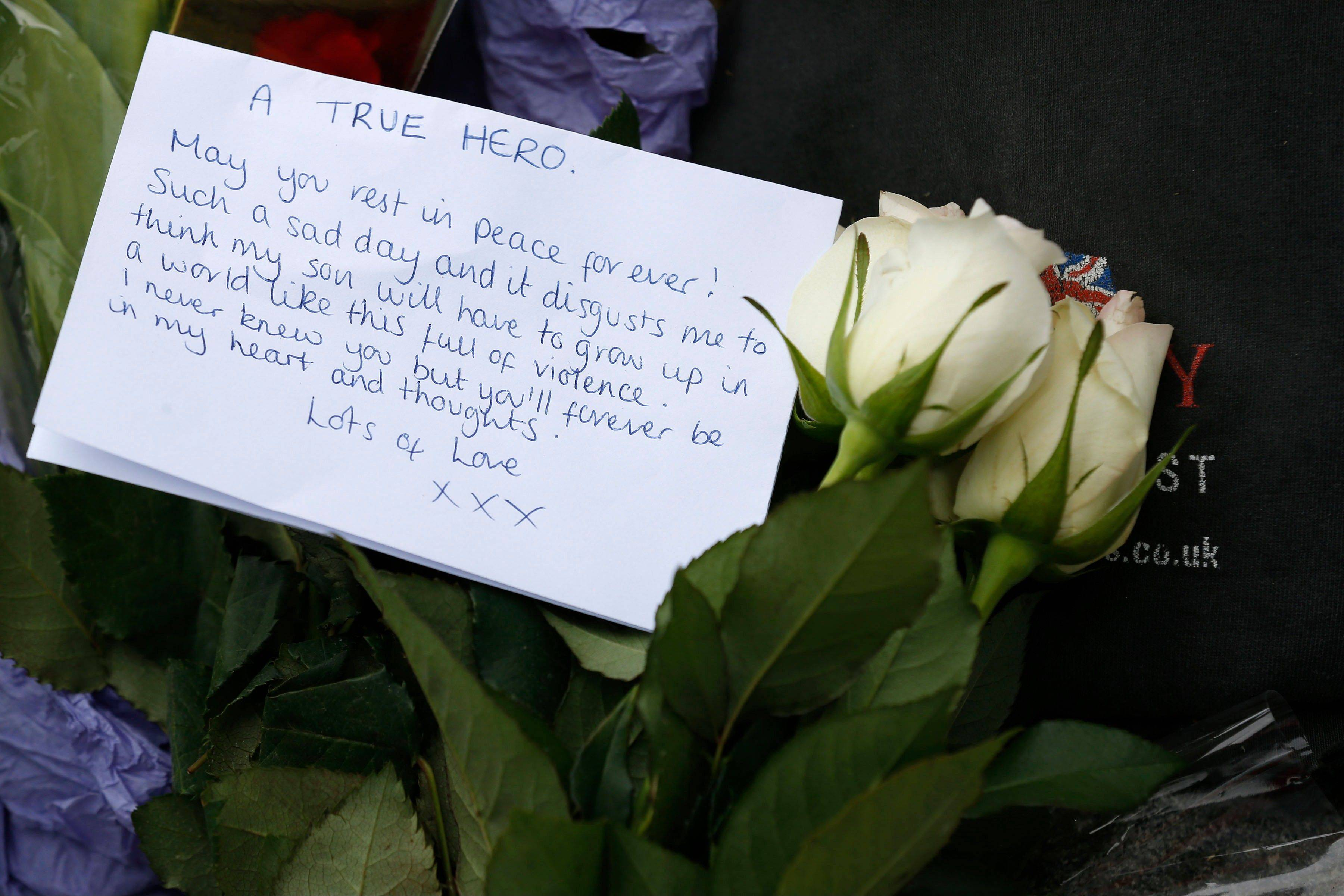 A floral tribute in memory of the victim is seen outside the Royal Artillery Barracks near the scene of a terror attack in Woolwich, southeast London, Thursday, May 23, 2013. The British government's emergency committee met Thursday after two attackers killed a man in a daylight attack in London that raised fears terrorism had returned to the capital.