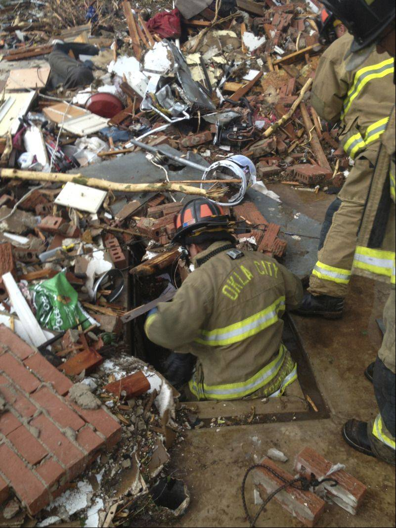 Firefighters work on Monday at the scene where Frank and Char Kozak were rescued in the aftermath of the Moore tornado.