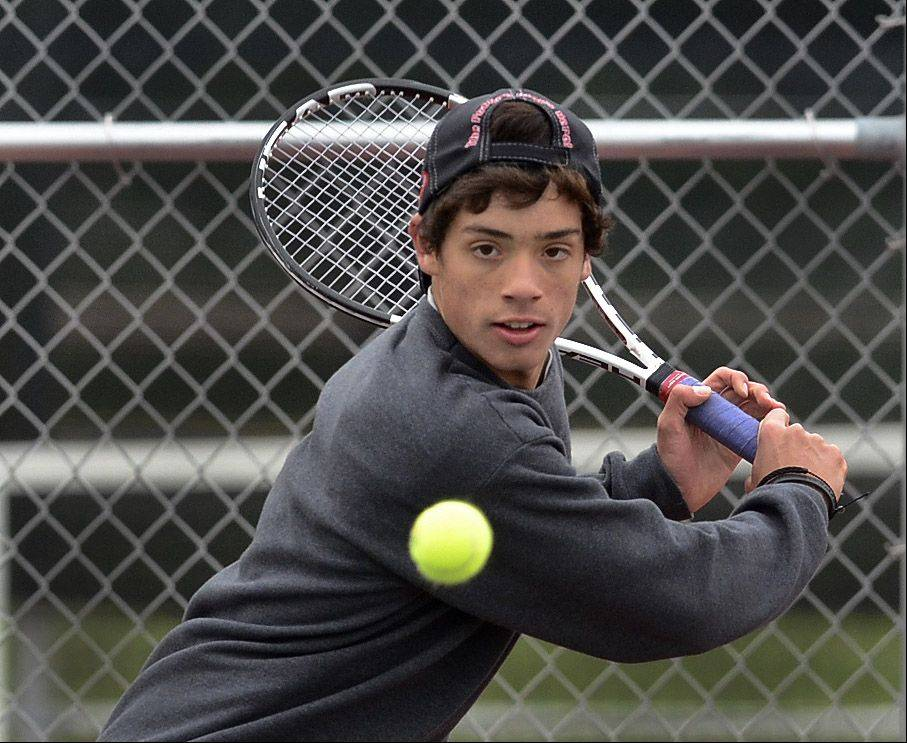 Glenbard North's Matt Krzyzaniak swings into action against Kristiyan Trukov of Warren in first-round singles play Thursday at Rolling Meadows.