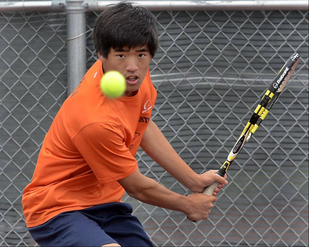 Benny Li of Naperville North competes against Brandon Harris of Edwardsville at Rolling Meadows High School on Thursday.