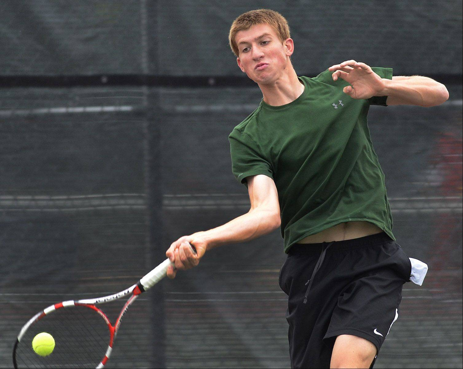Eric Marbach of Waubonsie Valley goes to his forehand during first-round singles play against Justin Bowman of St. Charles East on Thursday at Rolling Meadows.