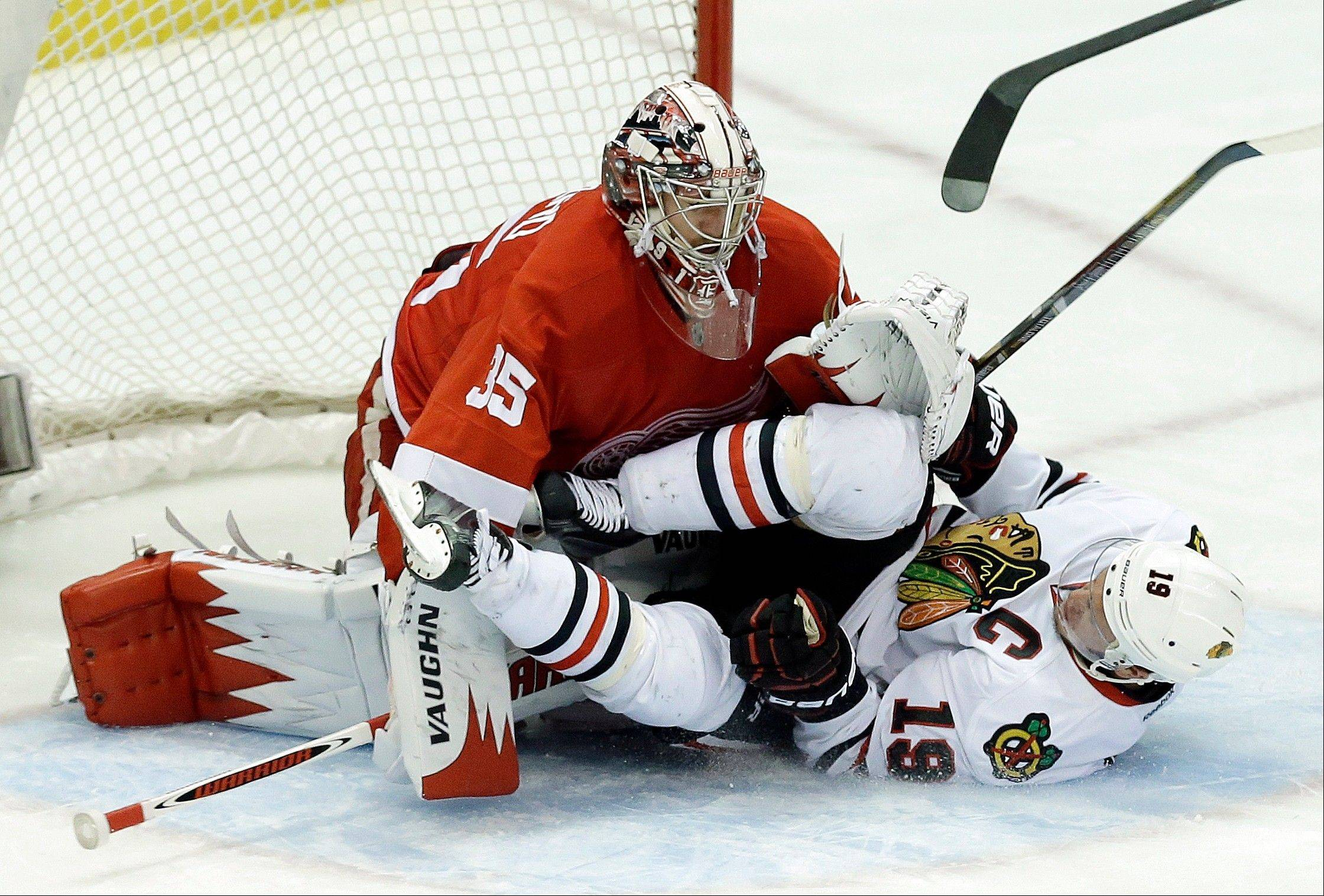Chicago Blackhawks center Jonathan Toews (19) crashes into Detroit Red Wings goalie Jimmy Howard (35) during the second period.