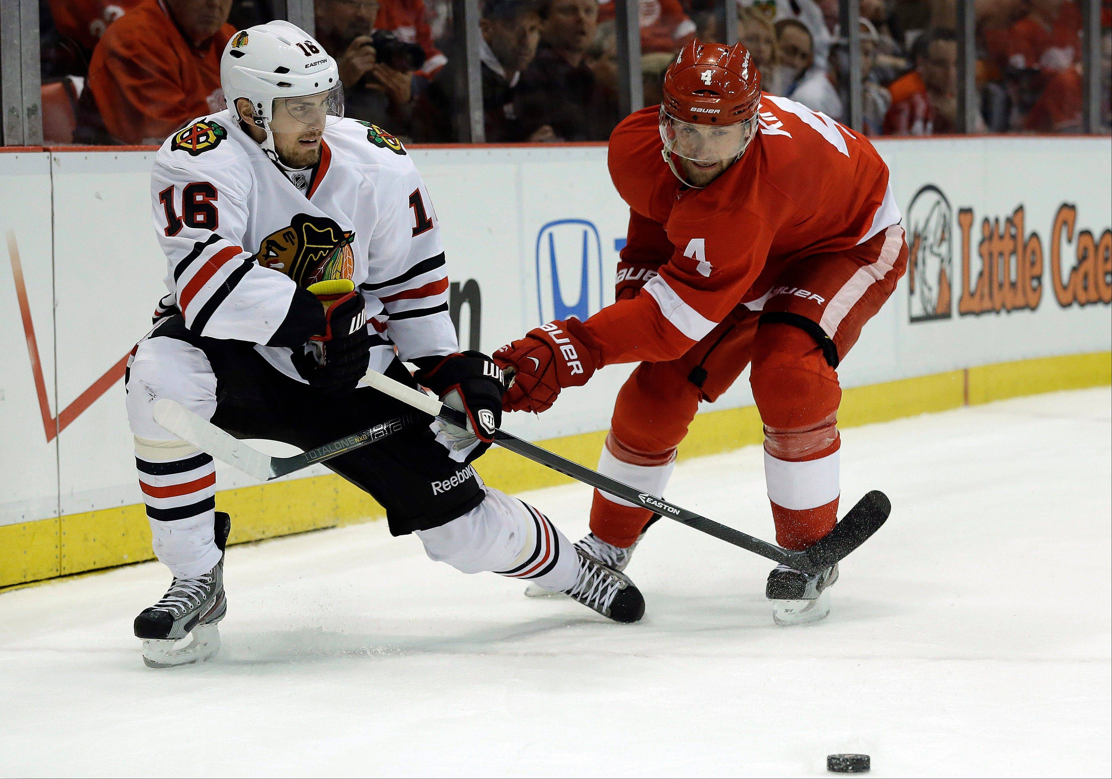 Detroit Red Wings defenseman Jakub Kindl (4), of the Czech Republic, defends against Chicago Blackhawks center Marcus Kruger (16), of Sweden, during the first period.