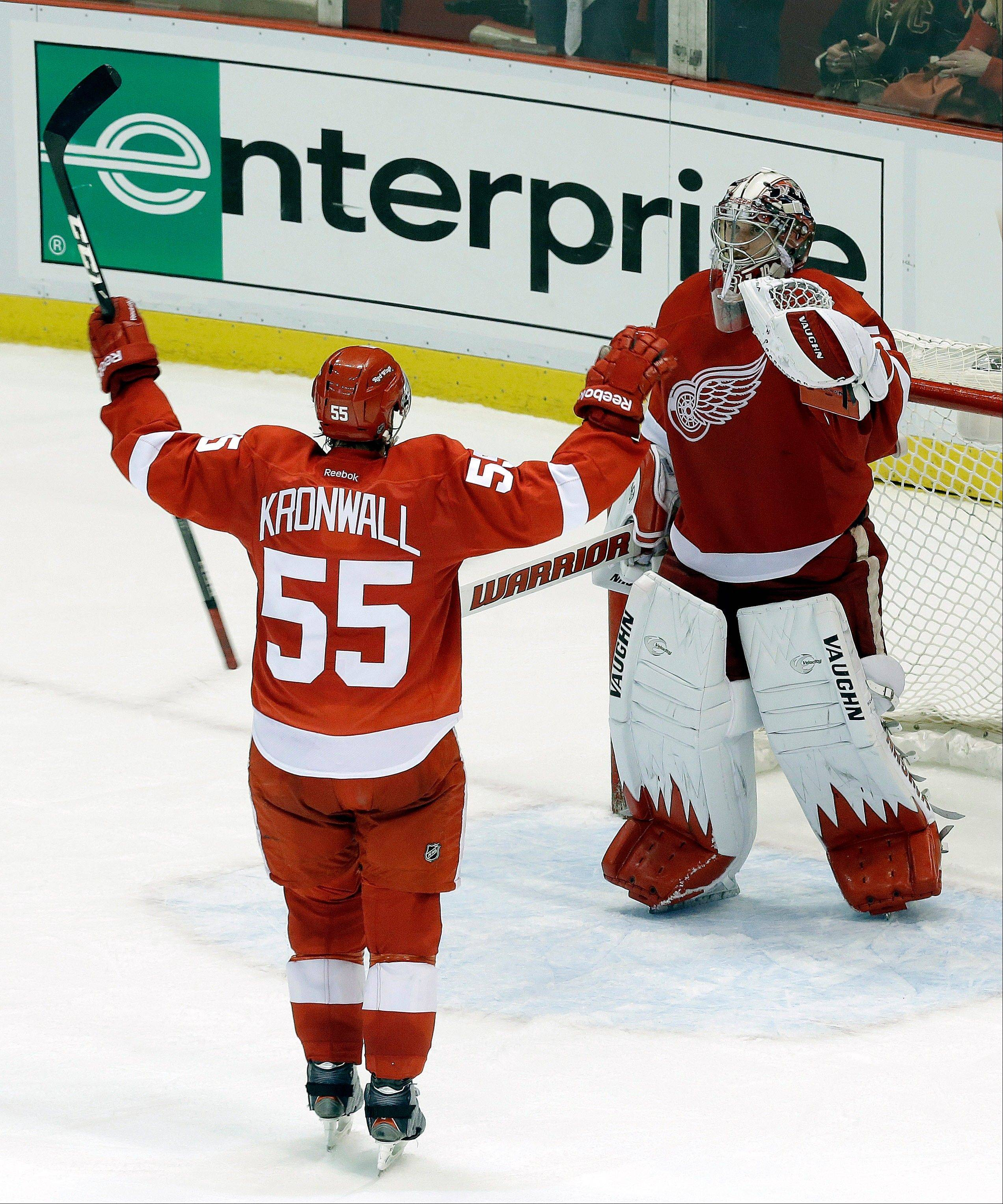 Detroit Red Wings defenseman Niklas Kronwall (55), of Sweden, celebrates with goalie Jimmy Howard (35) after defeating the Chicago Blackhawks 2-0.