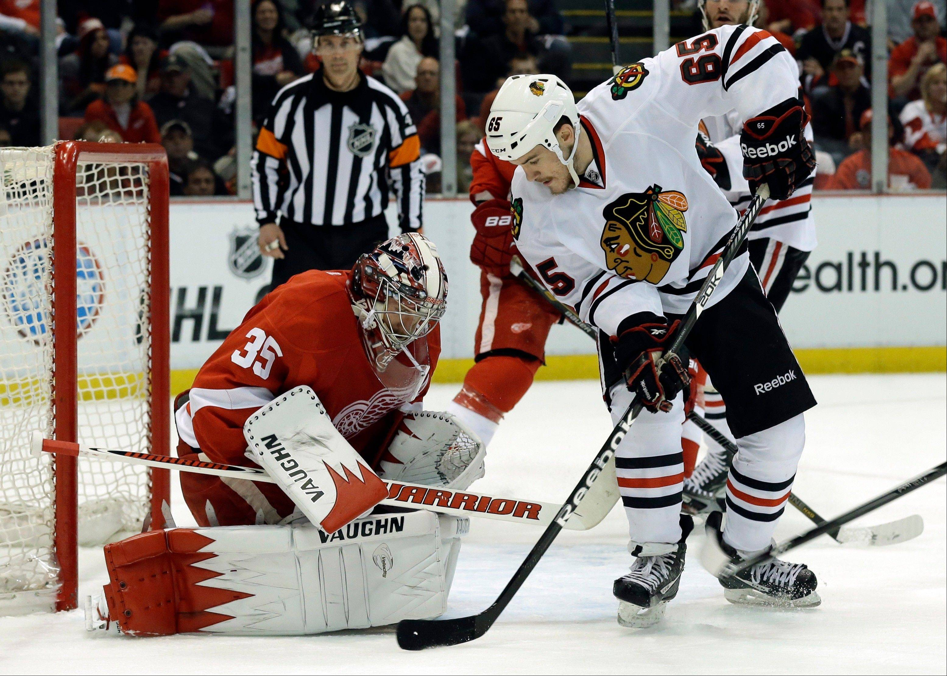 Detroit Red Wings goalie Jimmy Howard (35) stops a shot by Chicago Blackhawks center Andrew Shaw (65) during the first period.