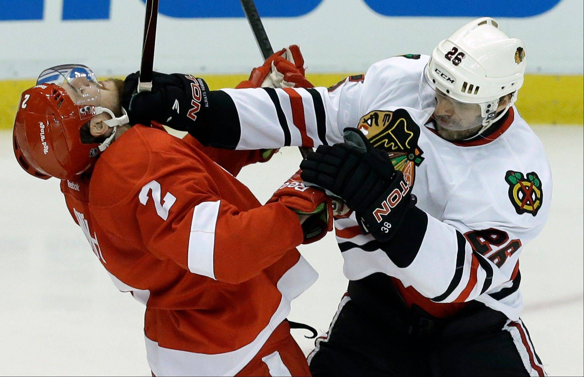 Chicago Blackhawks center Michal Handzus (26), of the Czech Republic, checks Detroit Red Wings defenseman Brendan Smith (2) during the second period.