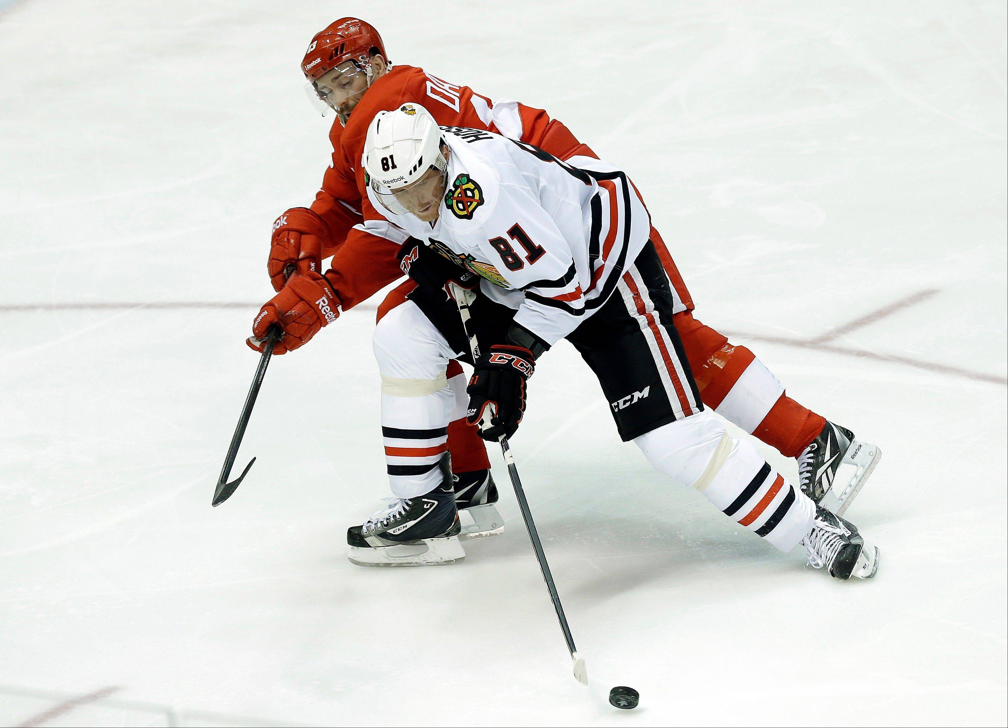 Chicago Blackhawks right wing Marian Hossa (81), of the Czech Republic, shields the puck from Detroit Red Wings center Pavel Datsyuk (13), of Russia, during the second period.
