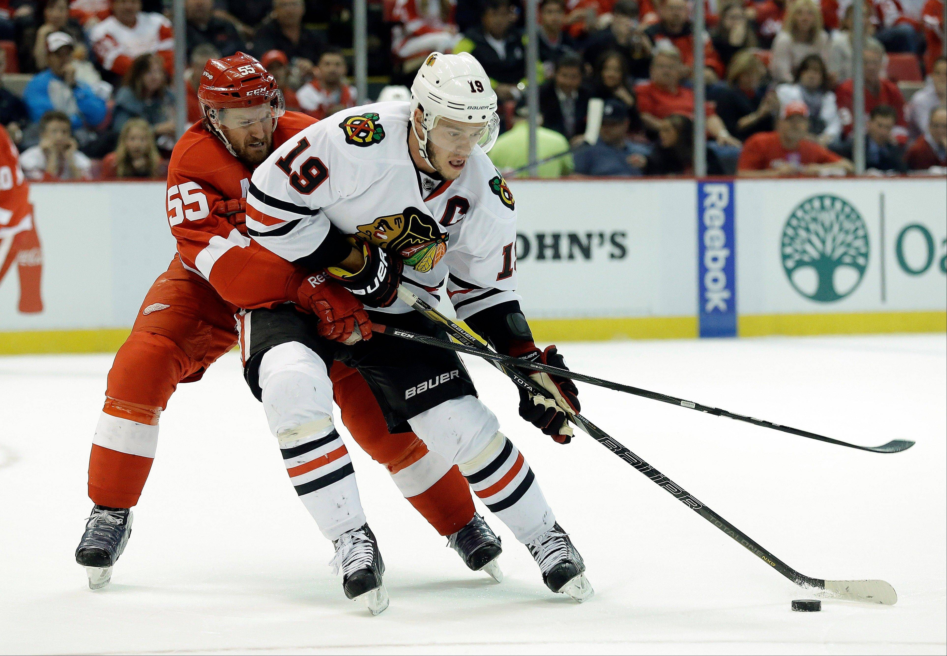 Detroit Red Wings defenseman Niklas Kronwall (55), of Sweden, defends Chicago Blackhawks center Jonathan Toews (19) during the first period.