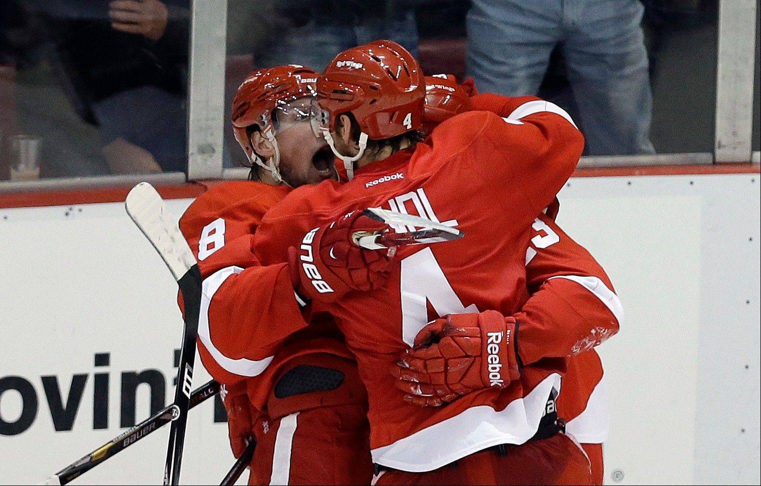 Detroit Red Wings defenseman Jakub Kindl (4), of the Czech Republic, celebrates his goal against the Chicago Blackhawks during the second period.