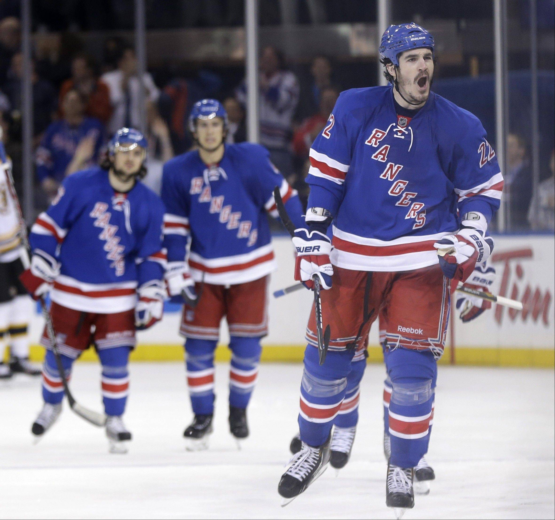 New York Rangers' Brian Boyle, right, reacts after scoring during the third period in Game 4 of the Eastern Conference semifinals against the Boston Bruins in the NHL hockey Stanley Cup playoffs in New York, Thursday, May 23, 2013, in New York.